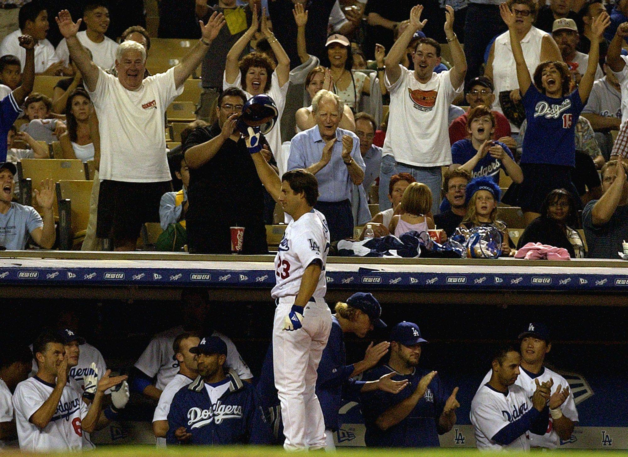 Los Angeles Dodgers' Robin Ventura takes a curtain call after hitting a grand slam off Arizona Diamondbacks pitcher Chad Durbin in the seventh inning at Dodger Stadium in Los Angeles on Tuesday, Sept. 7, 2004. Shawn Green, Jayson Werth, and Alex Cora also scored on the homer.