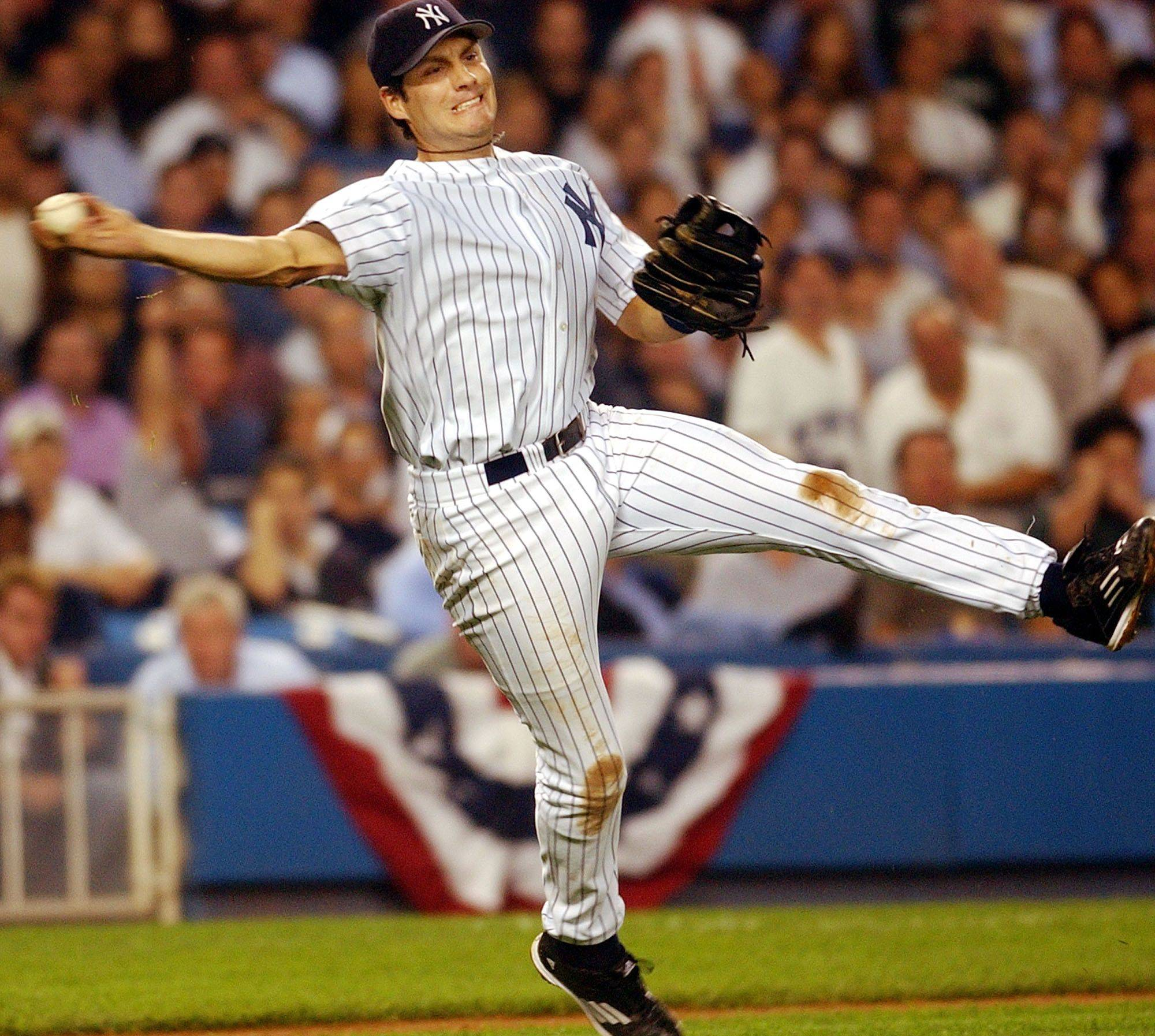 New York Yankees third baseman Robin Ventura makes an off-balance throw to put out Anaheim Angels batter David Eckstein during the third inning of Game 1 of American League Division Series, Tuesday, Oct. 1, 2002, at Yankees Stadium in New York.