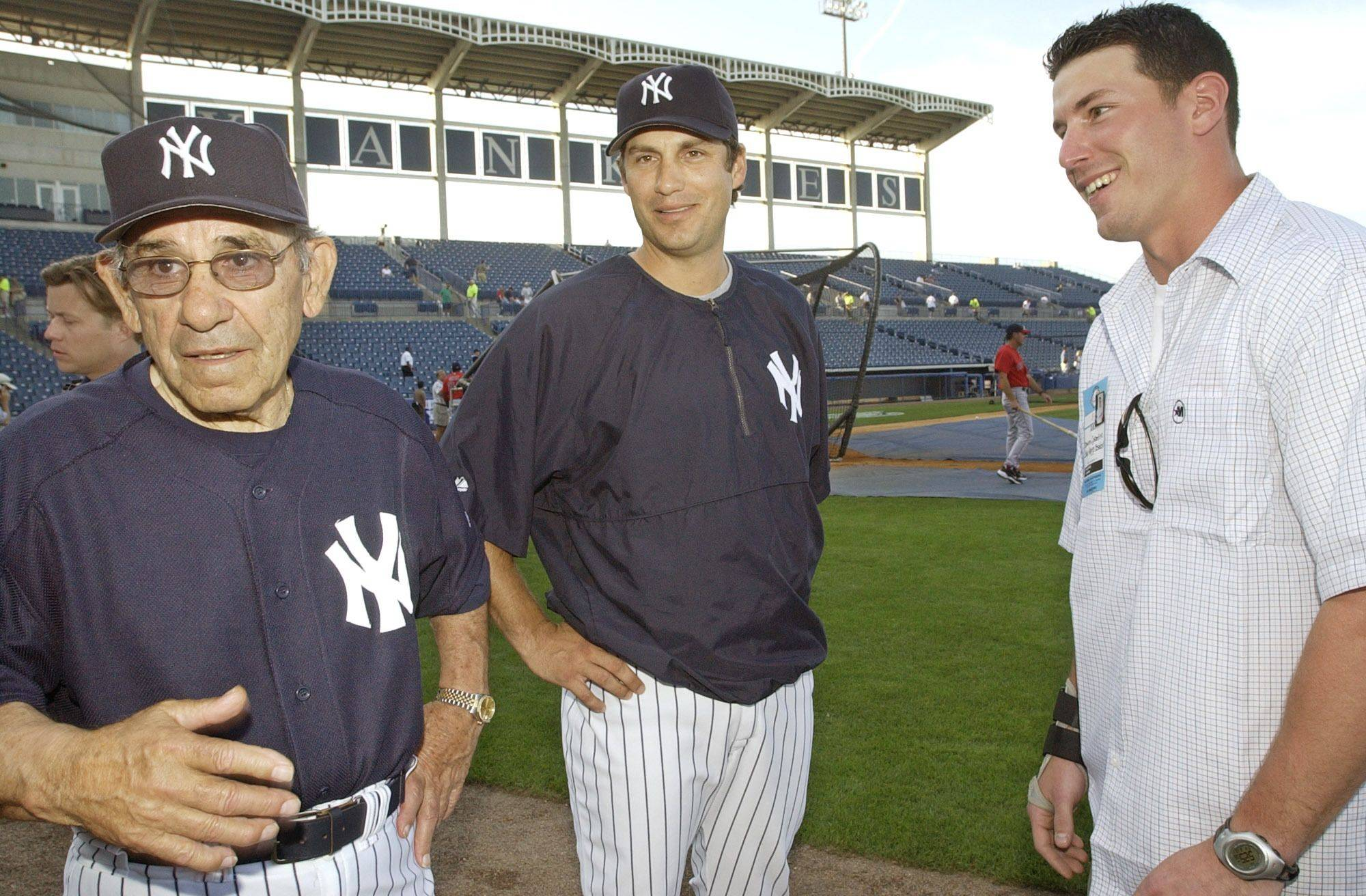 New York Yankees legend Yogi Berra, left, joins Yankees third baseman Robin Ventura, center and Damon Constantino of Salve Regina University in Newport, R.I., on the field before the Yankees night game against the Boston Red Sox, Thursday, March 13, 2003, in Tampa, Fla. Constantino set a new record for consecutive hits by a college baseball player with 60, breaking Ventura's record of 58 set in 1987 at Oklahomas State University.