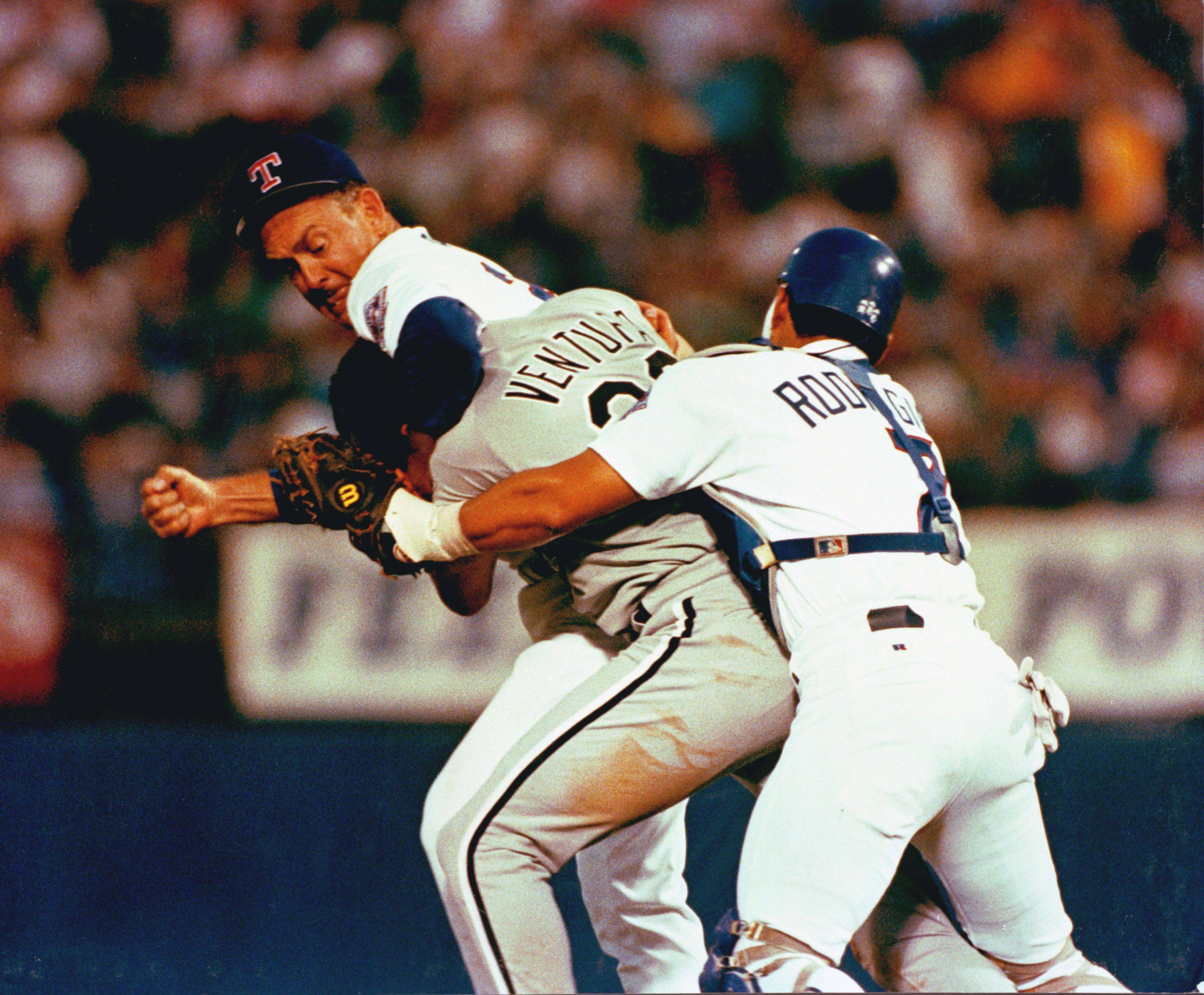 Texas Ranger pitcher Nolan Ryan hits Robin Ventura of the Chicago White Sox after Ventura charged the mound in Arlington, Tex., on Aug. 4, 1993.