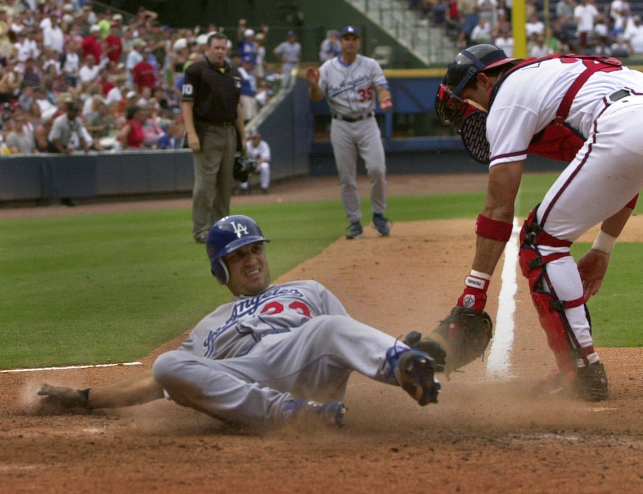 Los Angeles Dodgers Robin Ventura slides into home safe, for an inside-the-park home run as Atlanta Braves catcher Javy Lopez, right, makes a late tag in the seventh inning, Sunday, Aug. 3, 2003, at Turner Field in Atlanta. The Dodgers went on to defeat the Braves 8-4.
