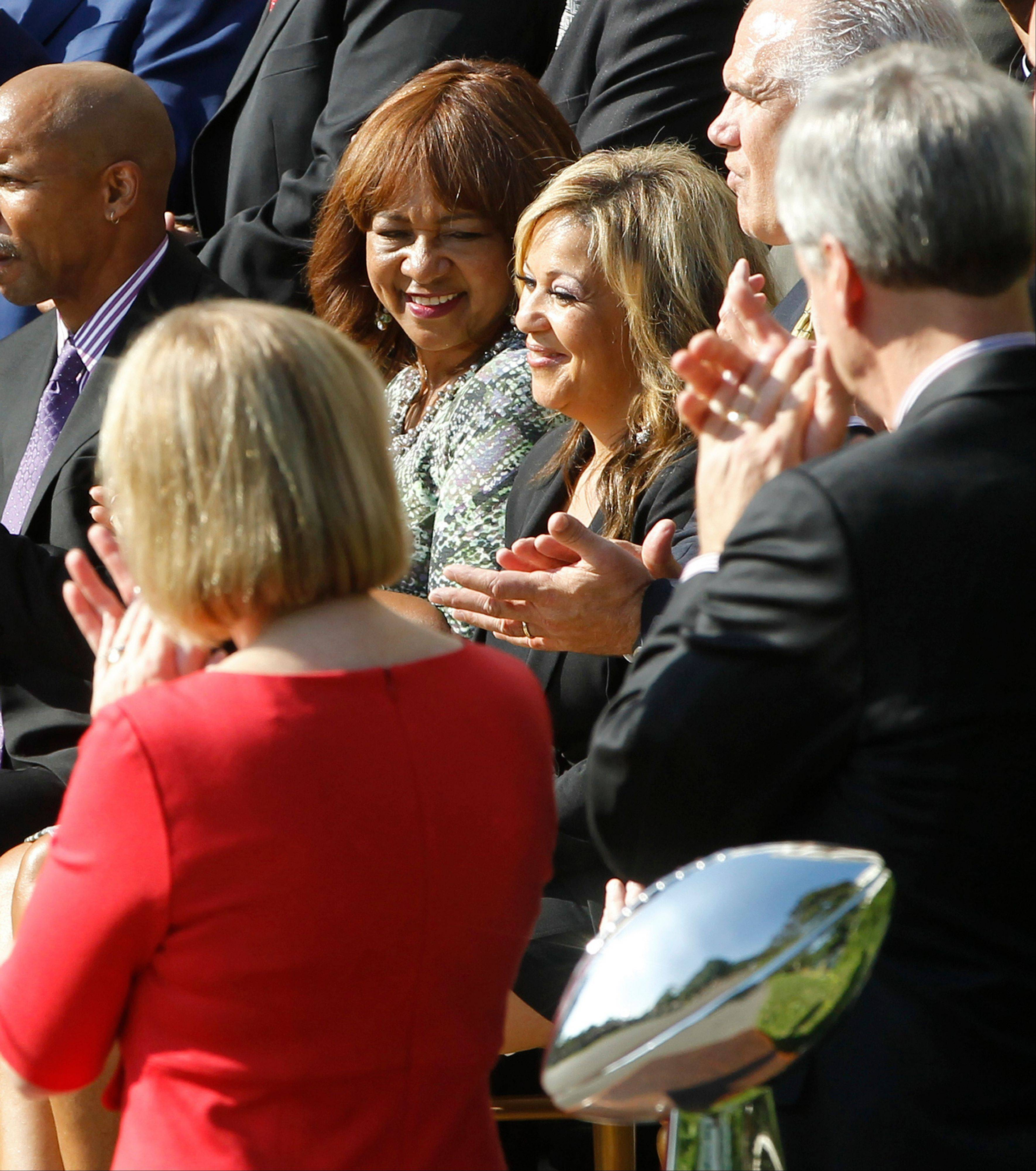 Connie Payton, wife of Walter Peyton, and Alicia Duerson, wife of Dave Duerson, are pictured as President Barack Obama honors the 1985 Super Bowl XX Champions Chicago Bears football team during a ceremony on the South Lawn of the White House in Washington, Friday, Oct. 7, 2011.