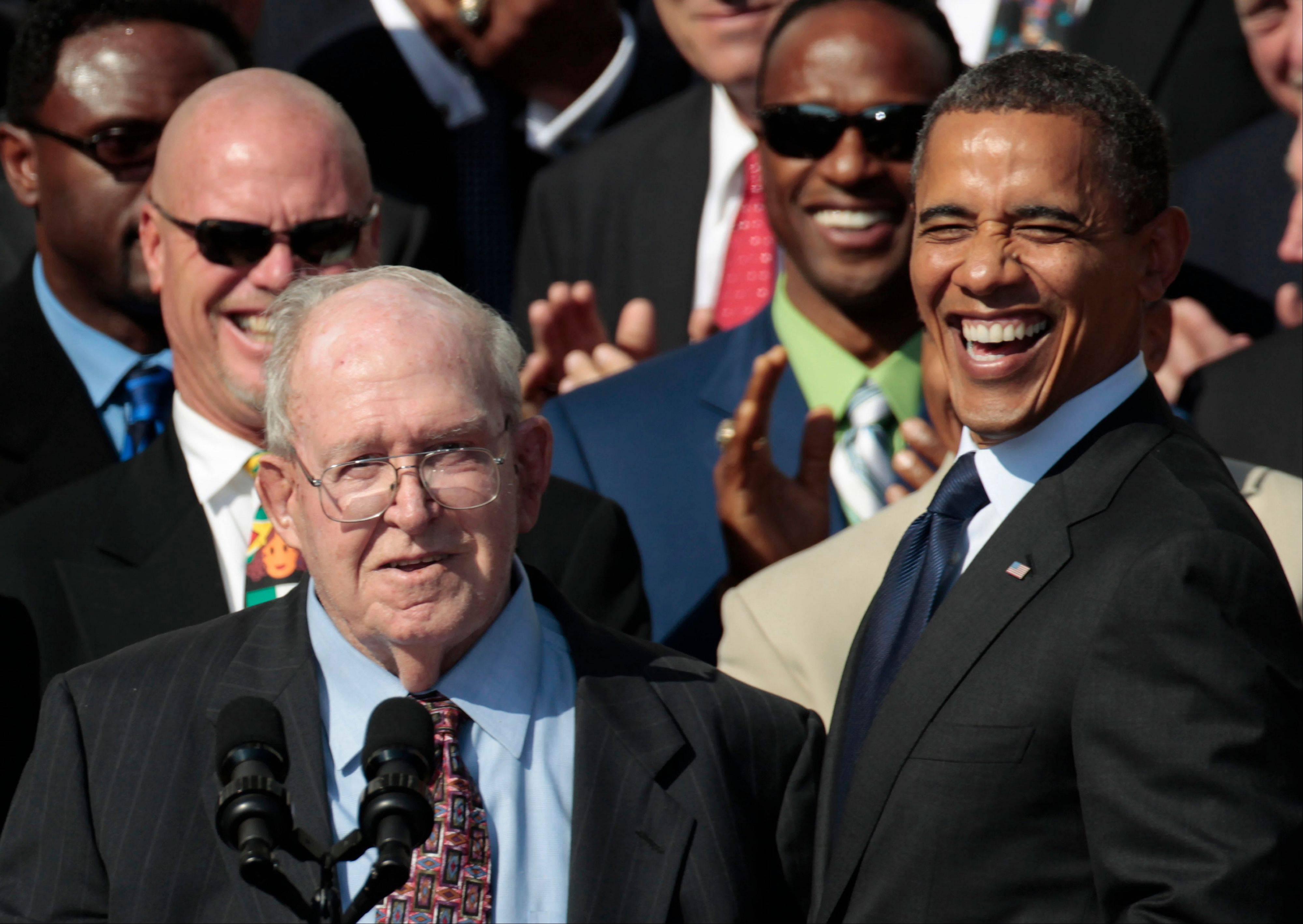 ASSOCIATED PRESSPresident Barack Obama, right, smiles at defensive coordinator Buddy Ryan, speaking left, as he stands with the 1985 Super Bowl XX Champions Chicago Bears football team during a ceremony on the South Lawn of the White House.