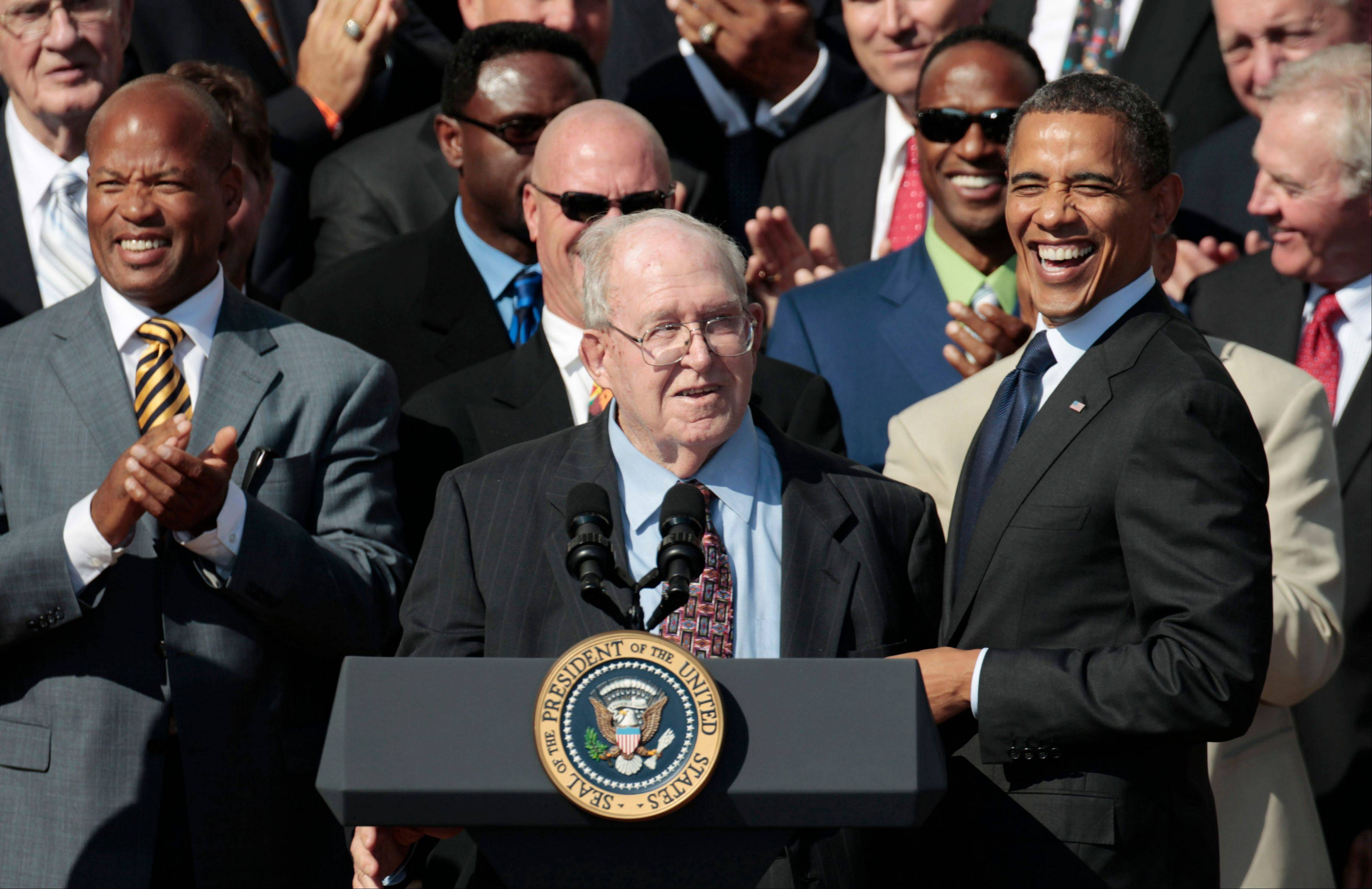 President Barack Obama, right, smiles at defensive cordinator Buddy Ryan, center, as he stands with the 1985 Super Bowl XX Champions Chicago Bears football team during a ceremony on the South Lawn of the White House in Washington, Friday, Oct. 7, 2011.