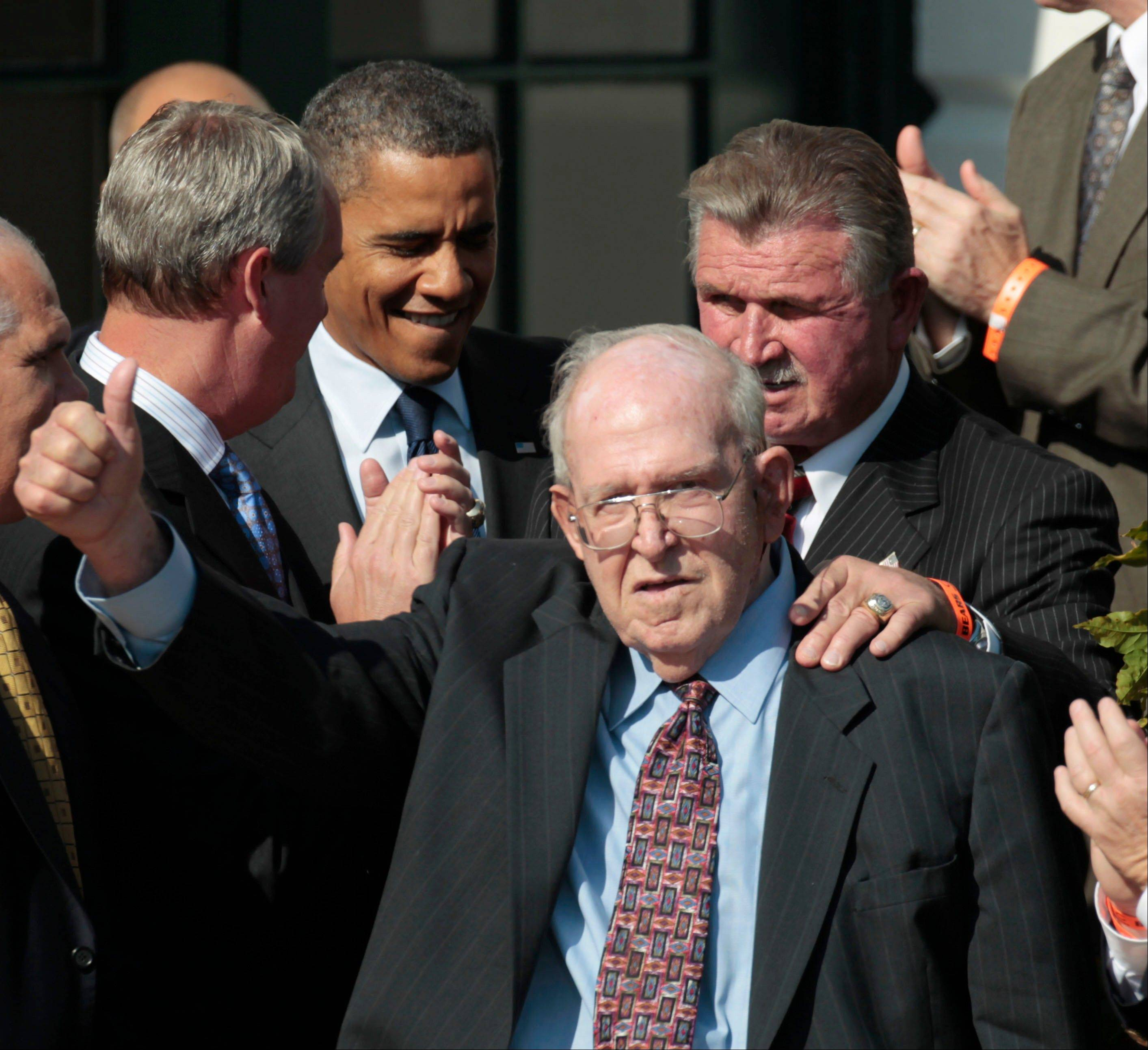 Former Bears' defensive coordinator Buddy Ryan, gives a 'thumbs-up' as he walks in with former head coach Mike Ditka, and President Barack Obama, during an event honoring the 1985 Super Bowl XX Champions Chicago Bears football team during a ceremony on the South Lawn of the White House in Washington, Friday, Oct. 7, 2011.