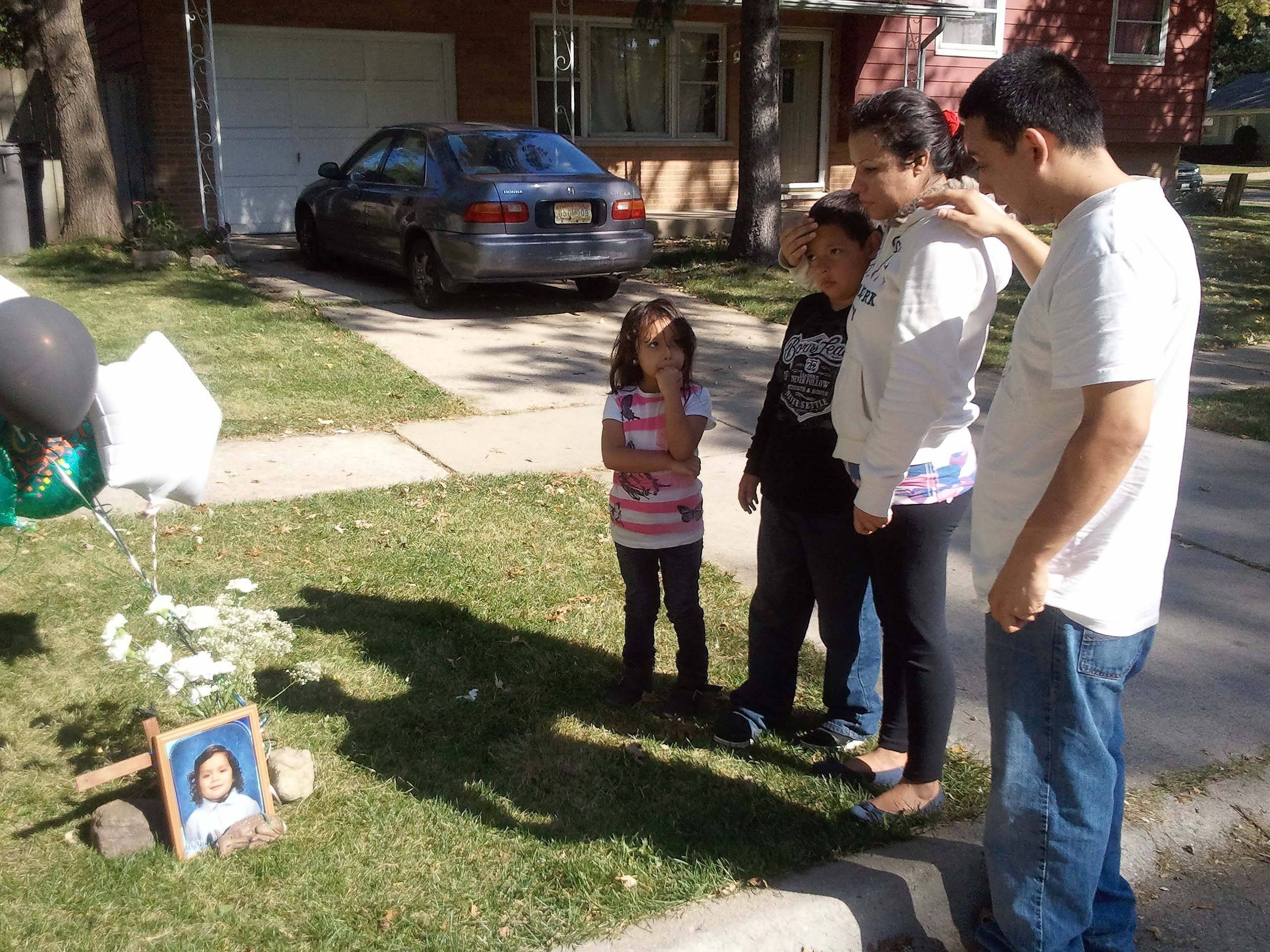 The death of 5-year-old Eric Galarza Jr. is mourned by neighbors Jorge Linares, from right, his wife Eglaen Padilla, and their children Jorge, 7, and Natalia, 5. Eric and his kids were at each other's houses almost every day, Jorge Linares said.