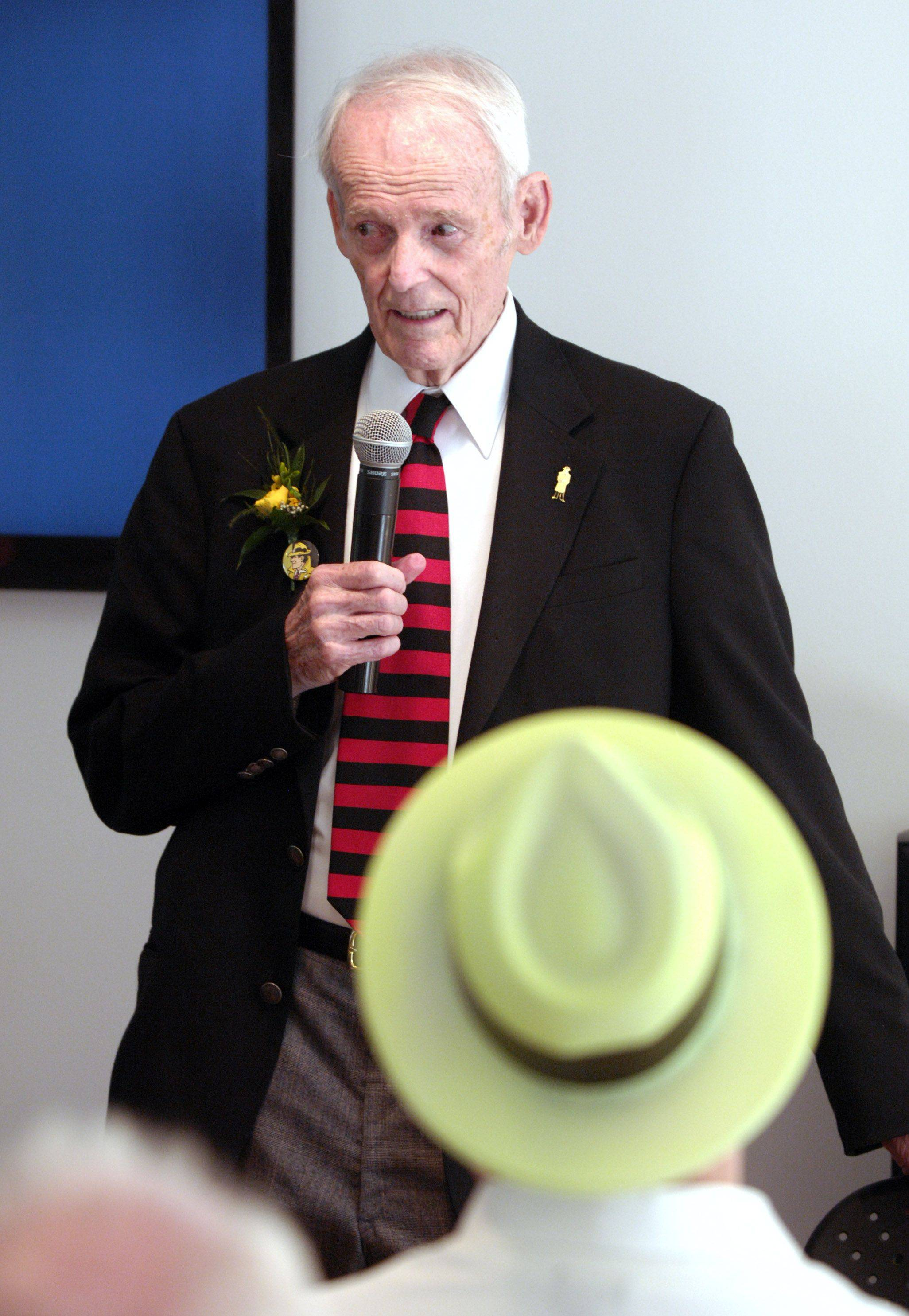 "Dick Locher, the Naperville man who drew the iconic cartoon ""Dick Tracy"" cartoon for many years, spoke at the Naper Settlement Sunday as part of a 80th birthday celebration for the cartoon character."