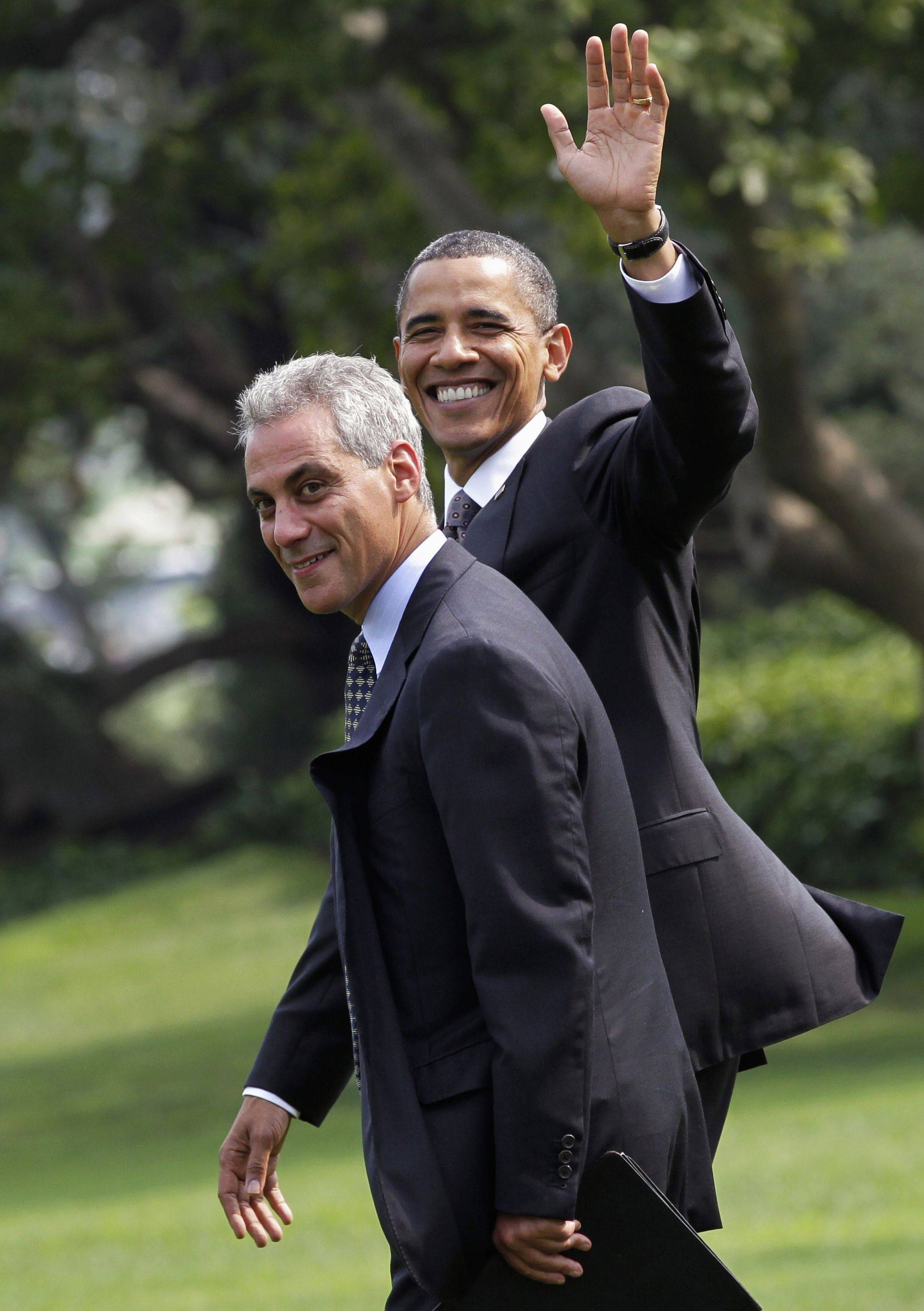 "In August 2010, President Barack Obama waves as he walks with then-White House Chief of Staff Rahm Emanuel to board his helicopter on the South Lawn of the White House in Washington. Chicago Mayor Emanuel defended Obama on Sunday's ""Meet the Press."""