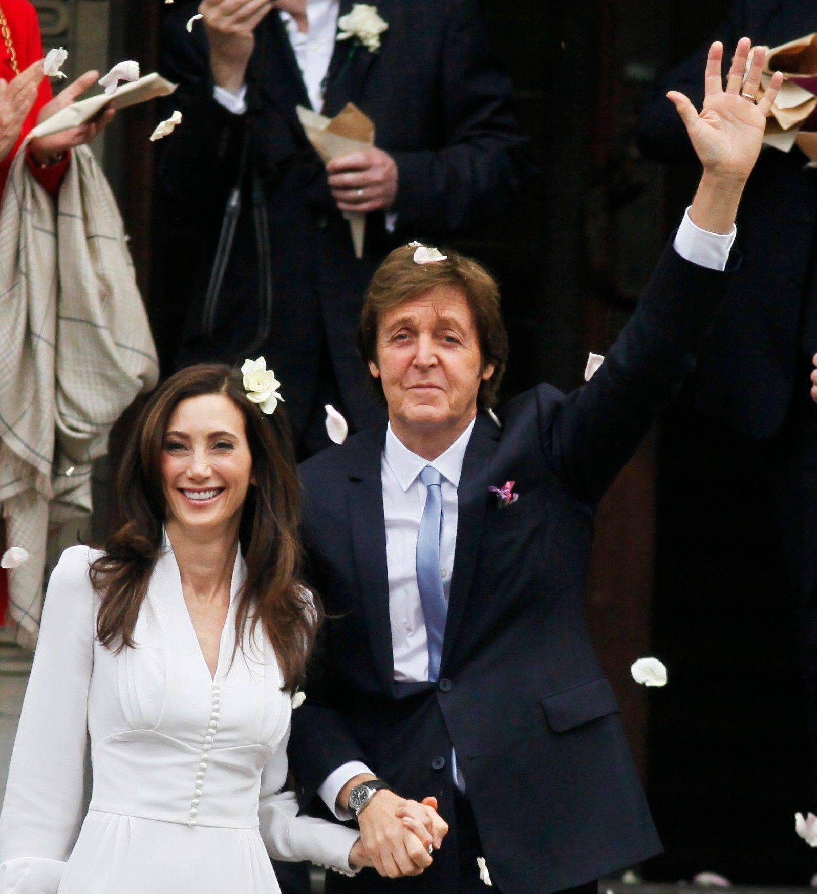 Former Beatle Paul McCartney and American heiress Nancy Shevell exit Marylebone Town Hall in central London after their wedding Sunday.