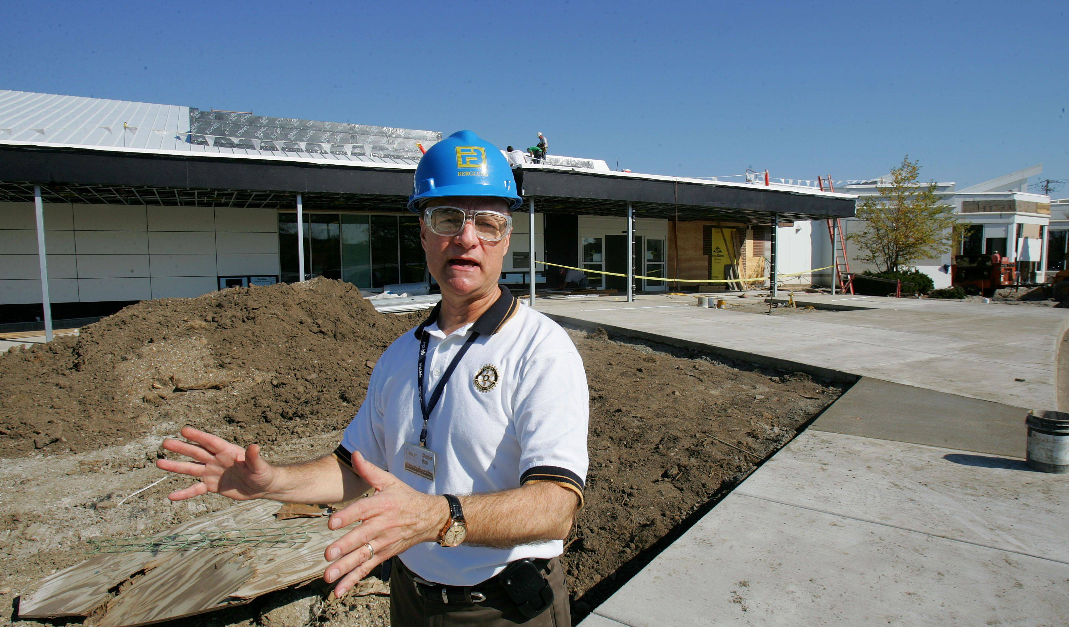 Warren-Newport Public Library Director Stephen Bero discusses a new main entrance as construction winds down. The library will reopen Oct. 17.