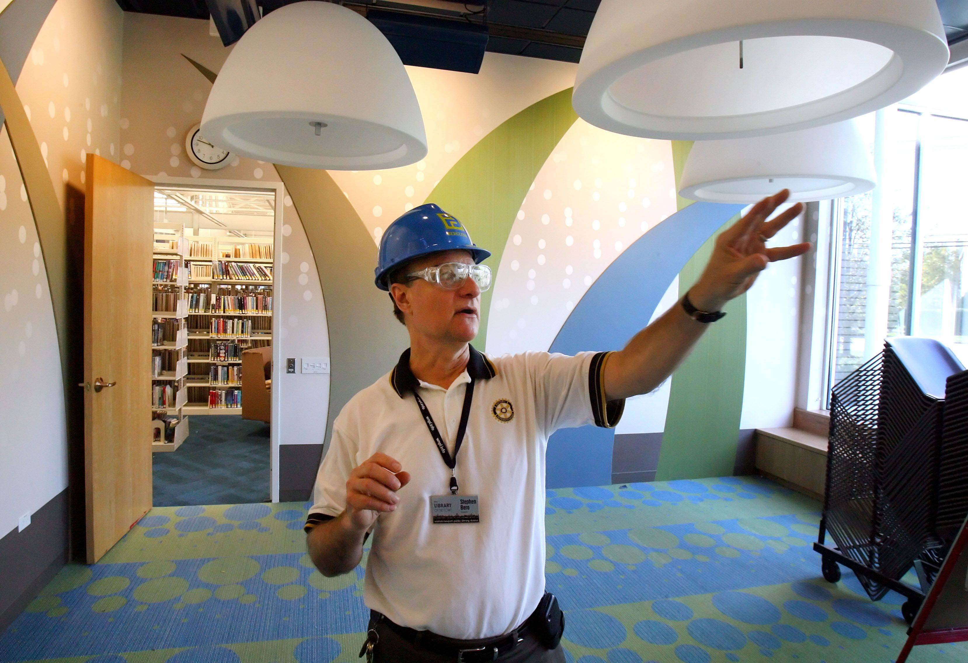 Warren-Newport Public Library Director Stephen Bero shows off a remodeled children's story time room.