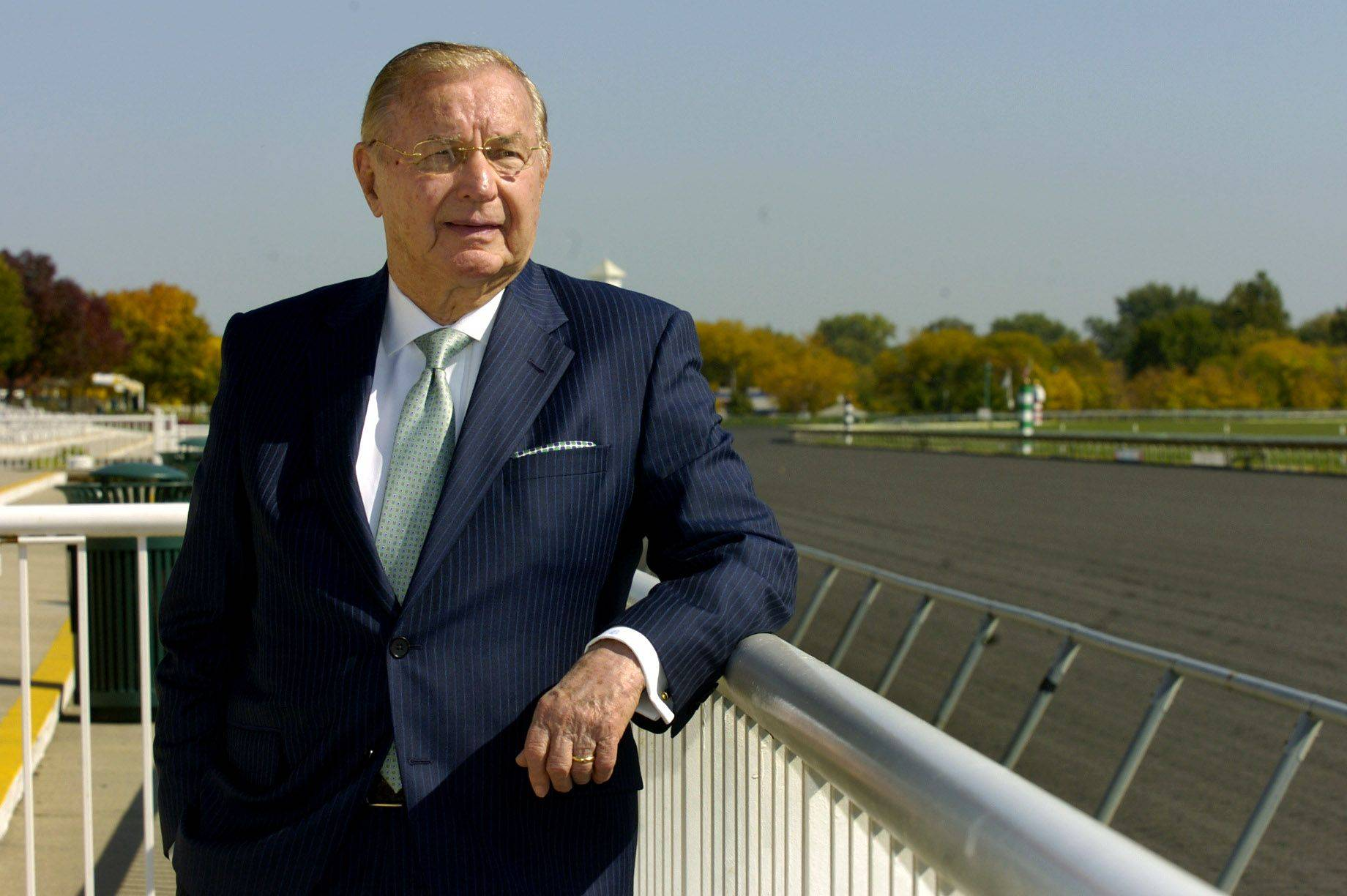 Arlington Park owner Richard Duchossois says he has strategies in place to keep the racetrack going whether it gets slots or not. Industry watchers are skeptical.