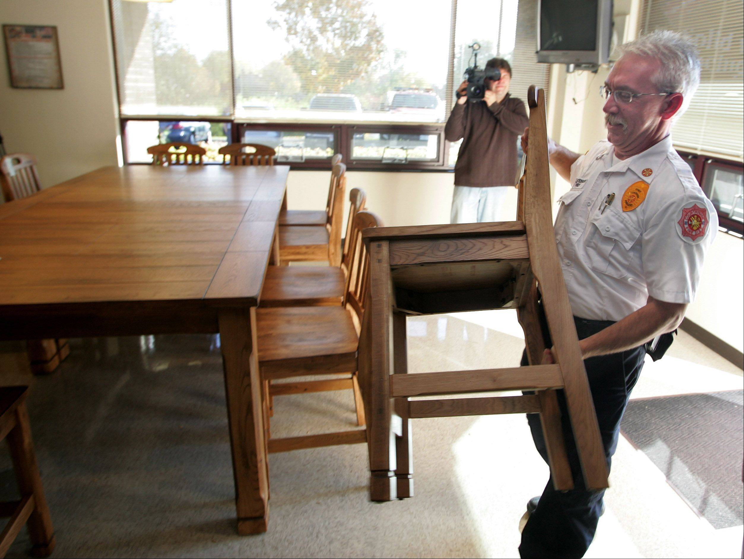 Countryside Fire Chief Jeff Steingart Brings In A Chair Monday As Part Of  The New Look