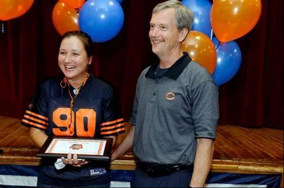 "Chicago Bears Chairman of the Board George McCaskey congratulates Camelot School teacher Crystal Lanski, one of this year's 16 ""Heroes in the Classroom"" in the Chicago area. The award is sponsored by Symetra Financial in partnership with the Bears."