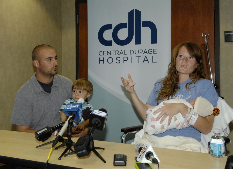 Amber Miller, 27, of Westchester, finished the Chicago Marathon on Sunday and then went to Central DuPage Hospital in Winfield where she gave birth to her second child, June. She met with media members Monday along with her husband Joe and their 19-month-old son Caleb.