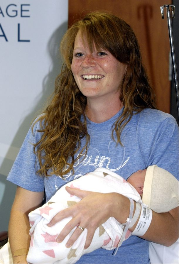 Amber Miller was 38 weeks and 5 days pregnant when she began the Chicago Marathon on Sunday. Before the day was over, she had given birth to her daughter June at Central DuPage Hospital in Winfield.