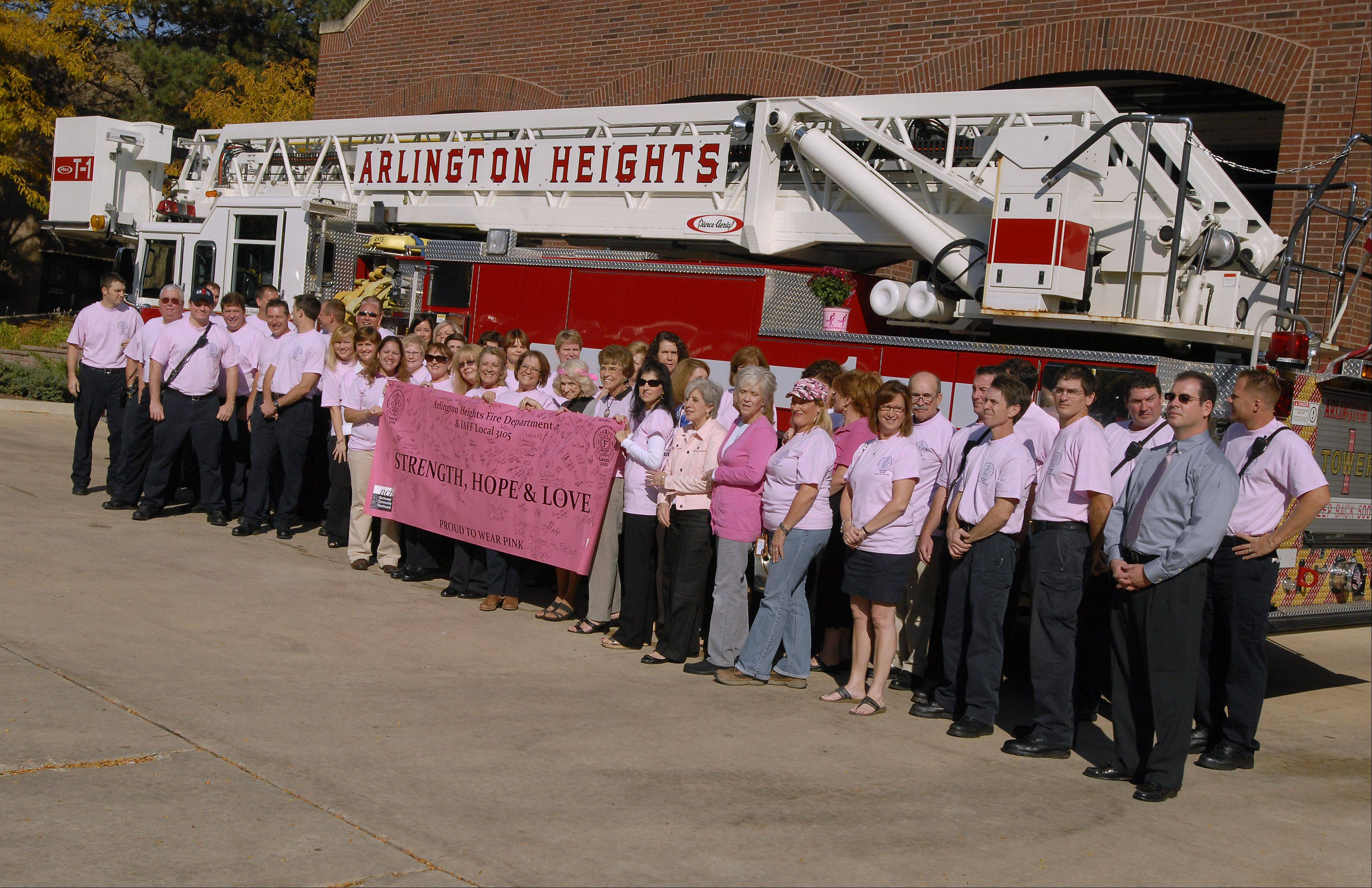 Village of Arlington Heights employees and firefighters stand in support of the Arlington Heights Fire Department Cancer Fund.