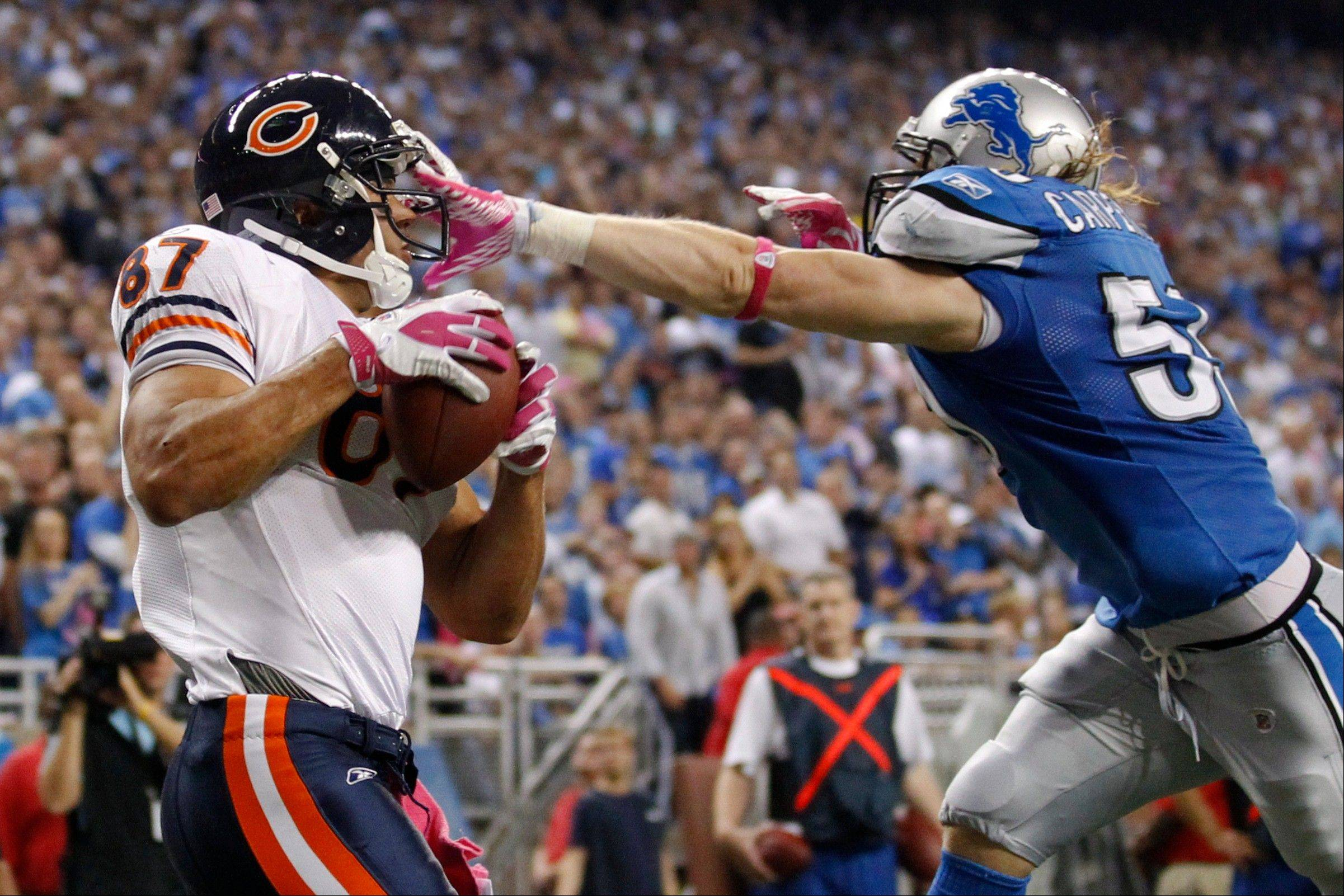 Chicago Bears tight end Kellen Davis (87) makes a 9-yard reception for a touchdown Monday as Detroit Lions outside linebacker Bobby Carpenter (59) defends in the second quarter of a game in Detroit.