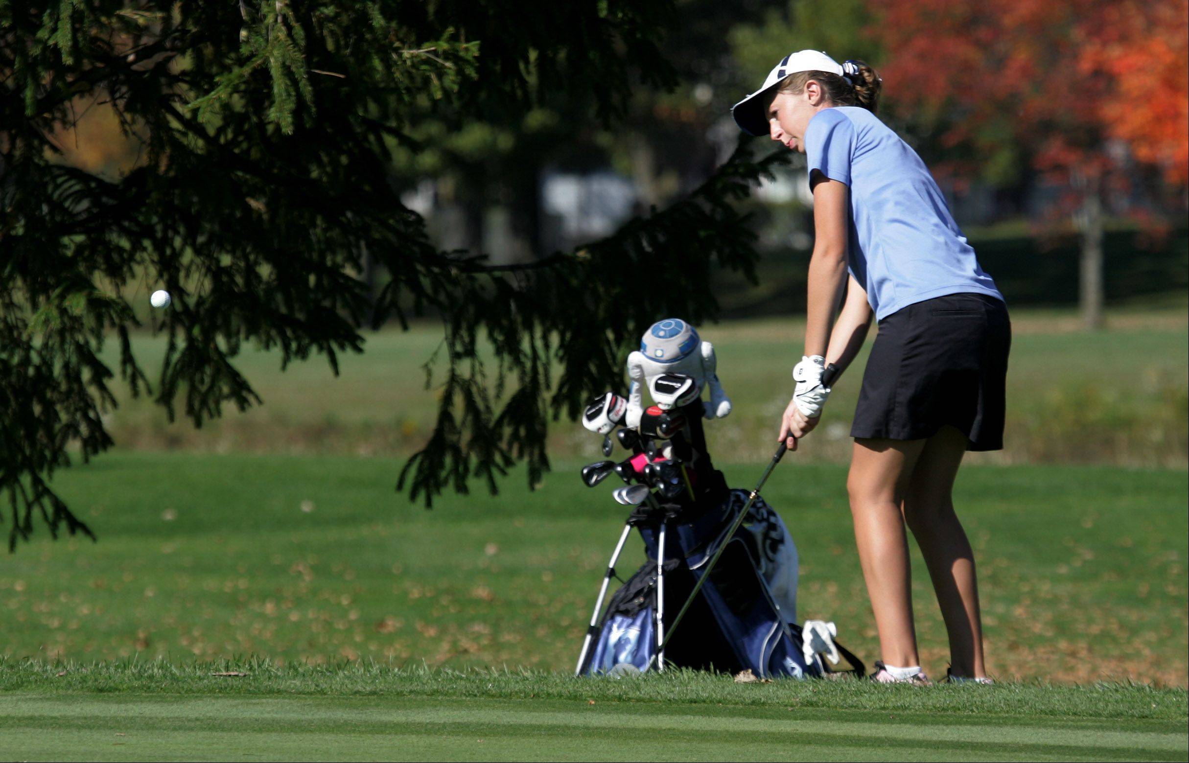 Prospect golfer Allison Walsh chips onto the green on the 10th hole during the Class 2A high school girls golf sectional Monday at Buffalo Grove Golf Club.