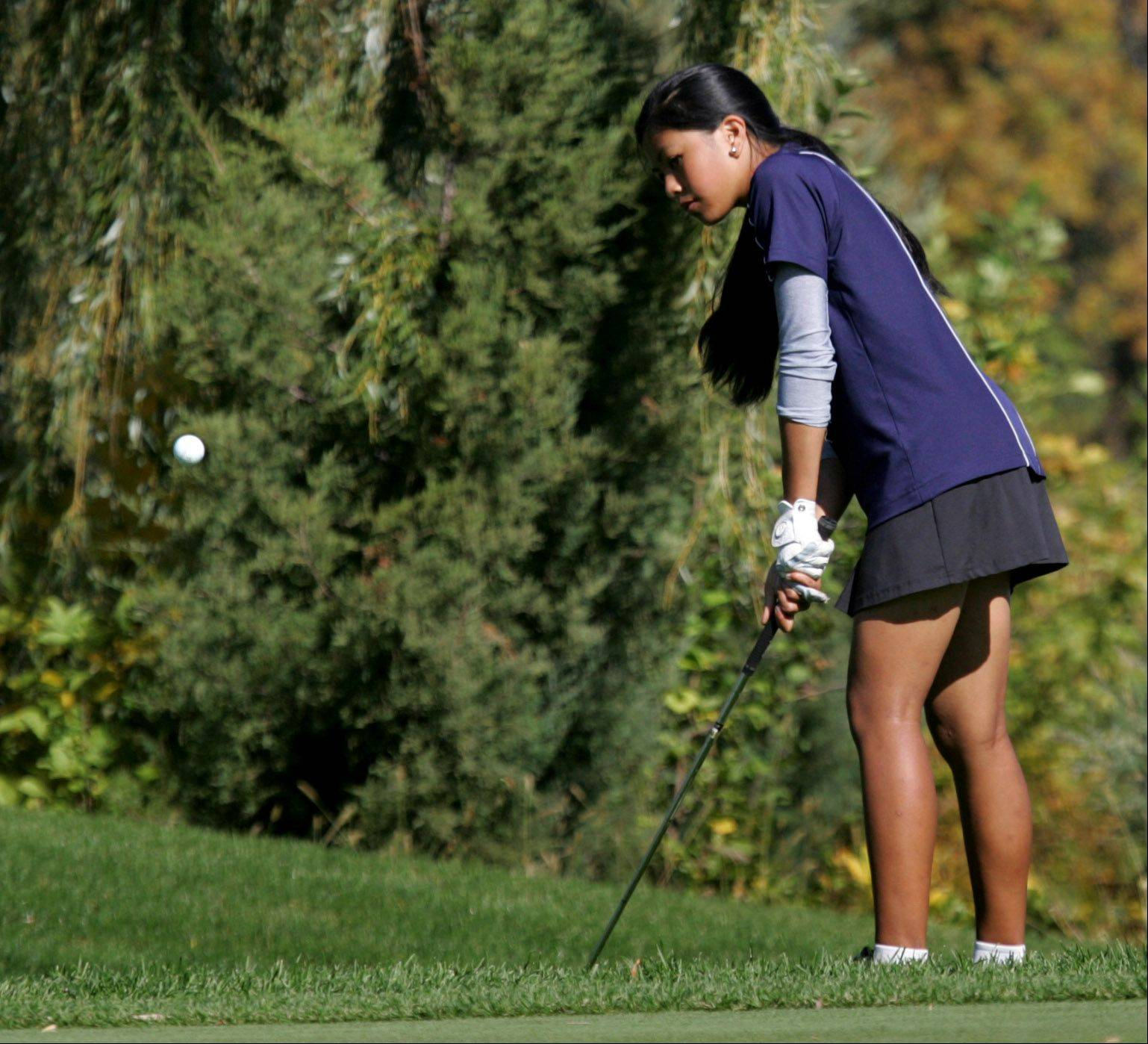 Buffalo Grove golfer Amber Guiao chips onto the green at the 16th hole during the Class 2A girls golf sectional Monday at Buffalo Grove Golf Club.