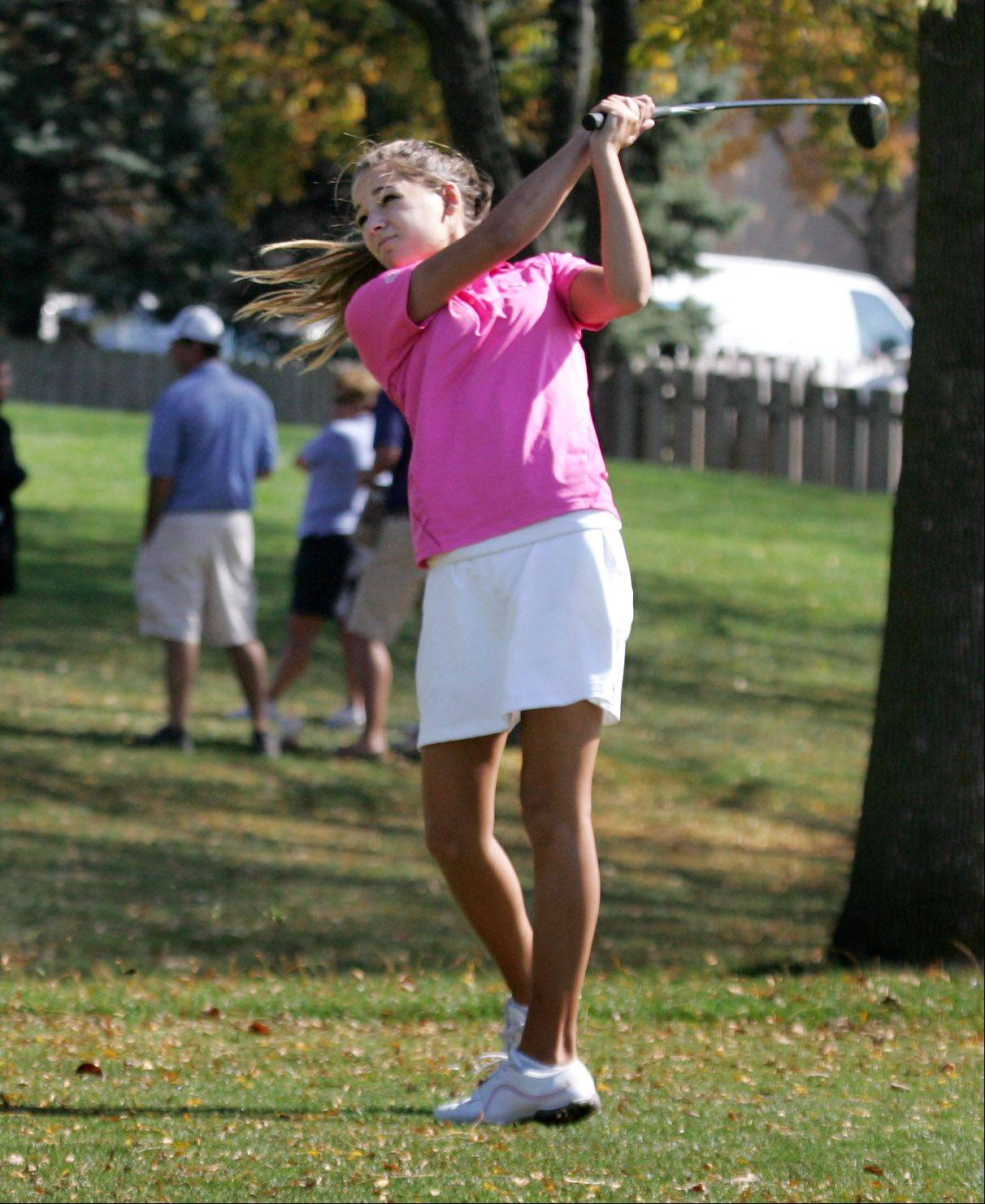 Carmel golfer Nikki Pavlis makes a drive during the Class 2A girls golf sectional Monday at Buffalo Grove Golf Club.
