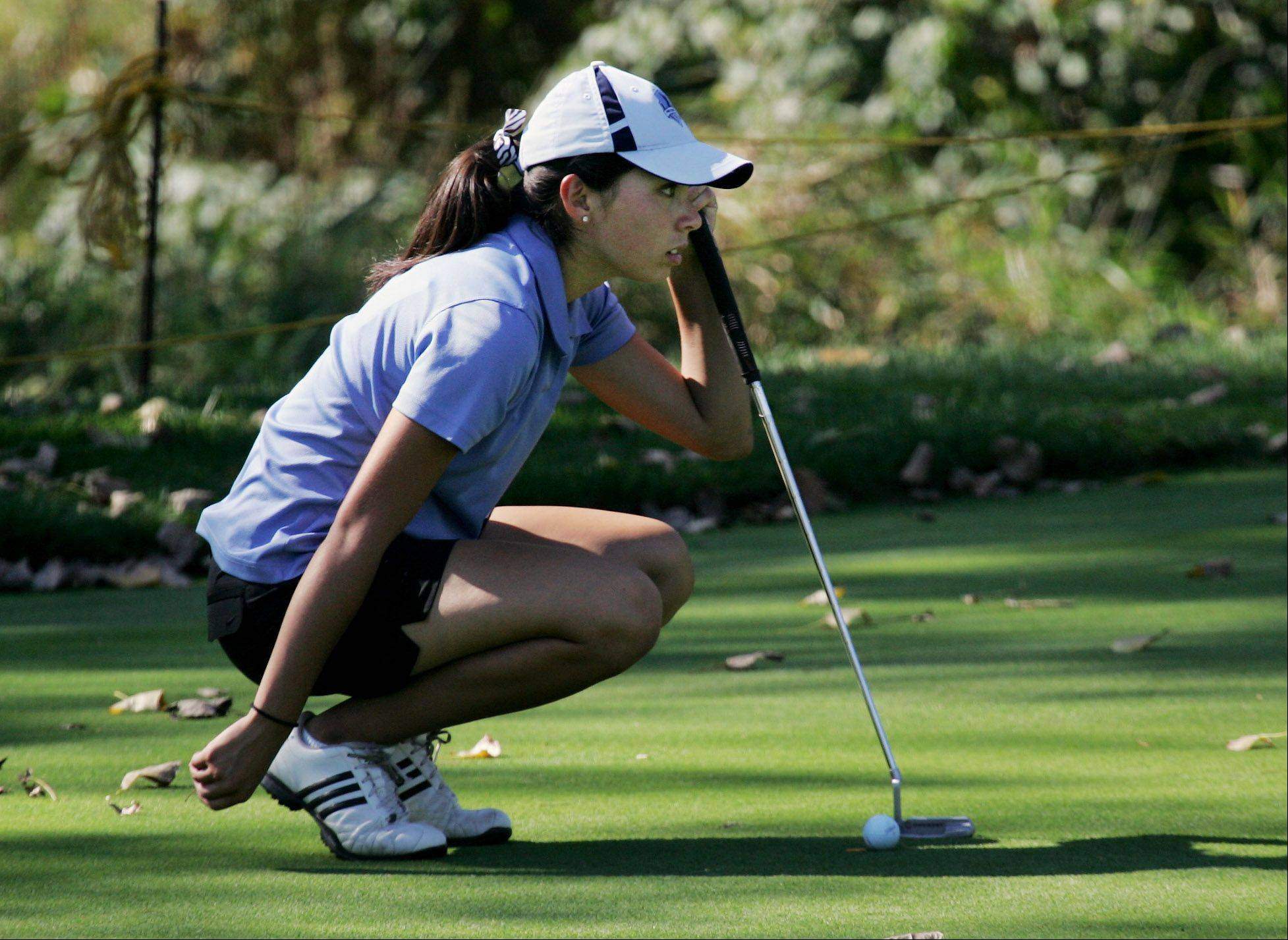 Prospect golfer Christine Garmoe lines up her putt on the tenth hole during the Class 2A girls golf sectional Monday at Buffalo Grove Golf Club.