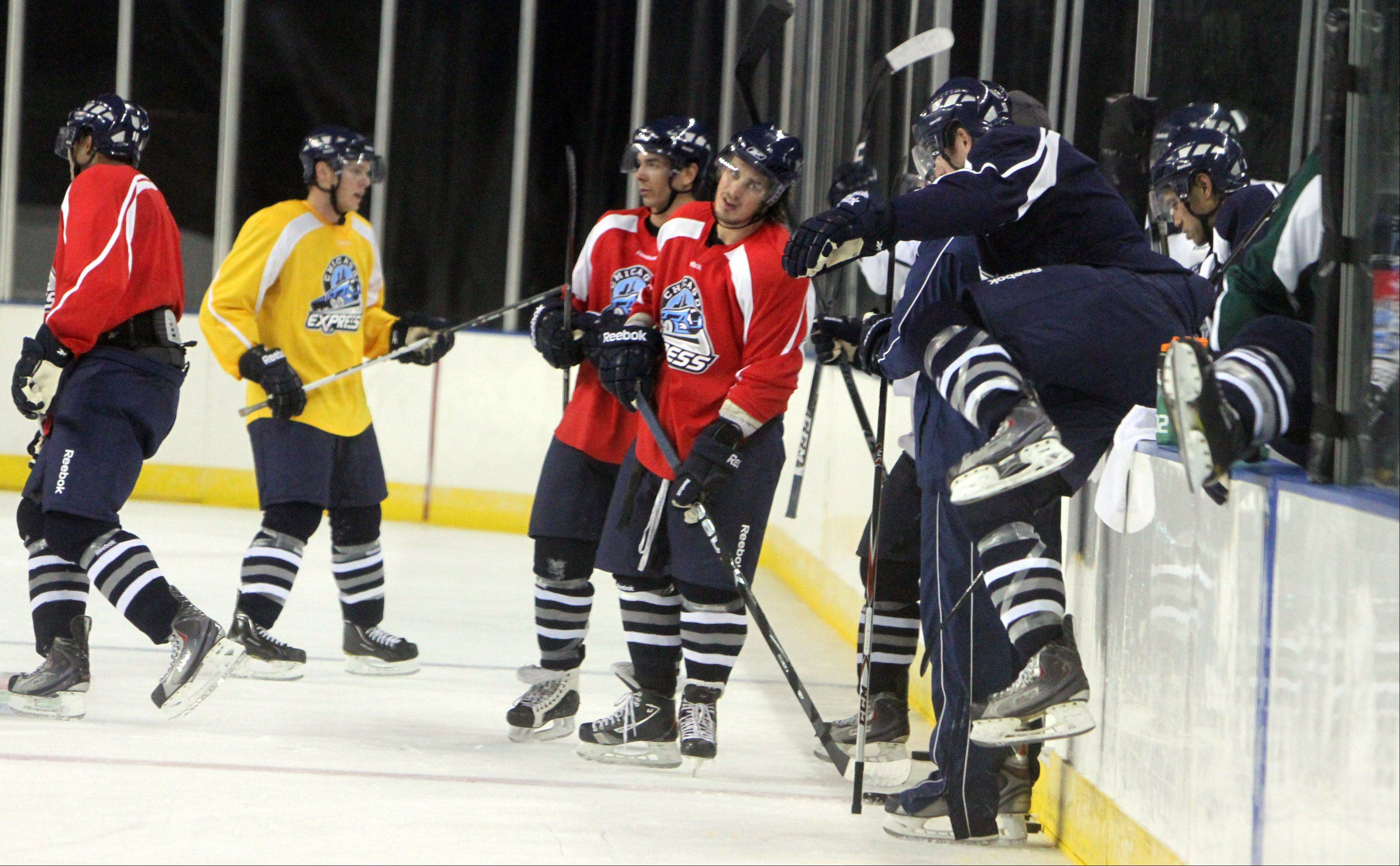 Members of the Chicago Express change lines during practice.
