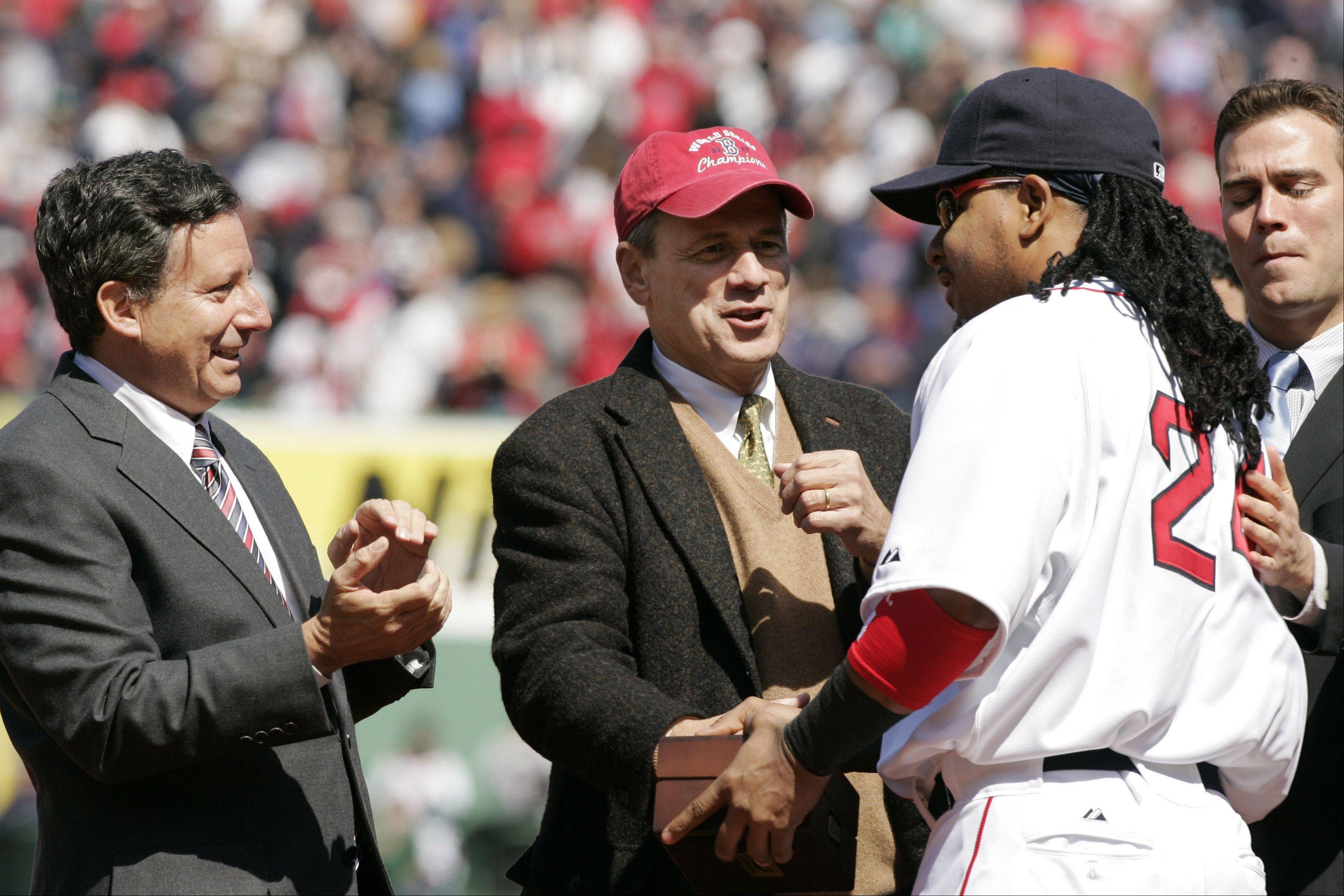 Boston Red Sox's Manny Ramirez, second from right, is present with a world championship ring by, from left, team Chairman and co-owner Tom Werner, team President and CEO Larry Lucchino, and general manager Theo Epstein during ceremonies at the baseball team's homer opener at Boston's Fenway Park, Tuesday, April 8, 2008. The Red Sox played the Detroit Tigers in the game.
