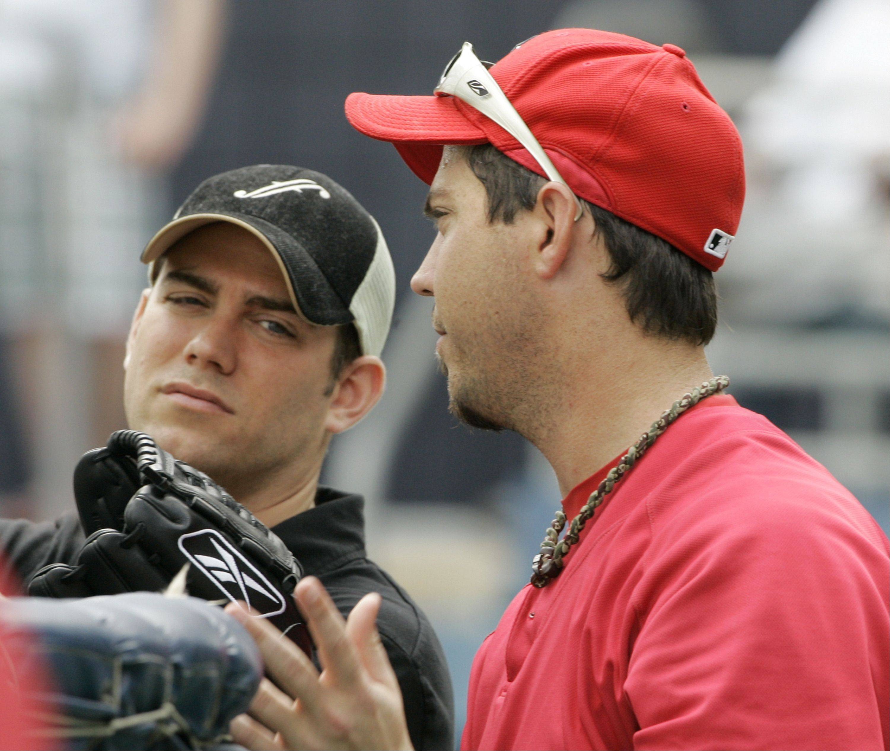 Boston Red Sox general manager Theo Epstein, left, and pitcher Josh Beckett talk during a team baseball practice in Fort Myers, Fla., in this March 7, 2008 file photo. Theo Epstein took risks that paid off with the Red Sox first championship in 86 years, sparking celebrations by long-suffering fans in 2004.
