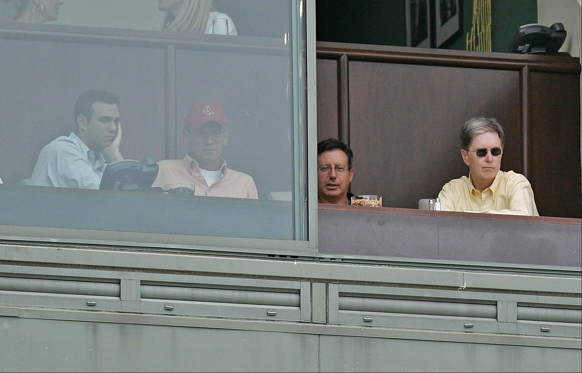 Boston Red Sox', left to right, General Manager Theo Epstein, CEO Larry Lucchino, and owners Tom Werner and John Henry take in the Red Sox 11-3 win over the Detroit Tigers at Fenway Park in Boston Sunday, Aug. 28, 2005.
