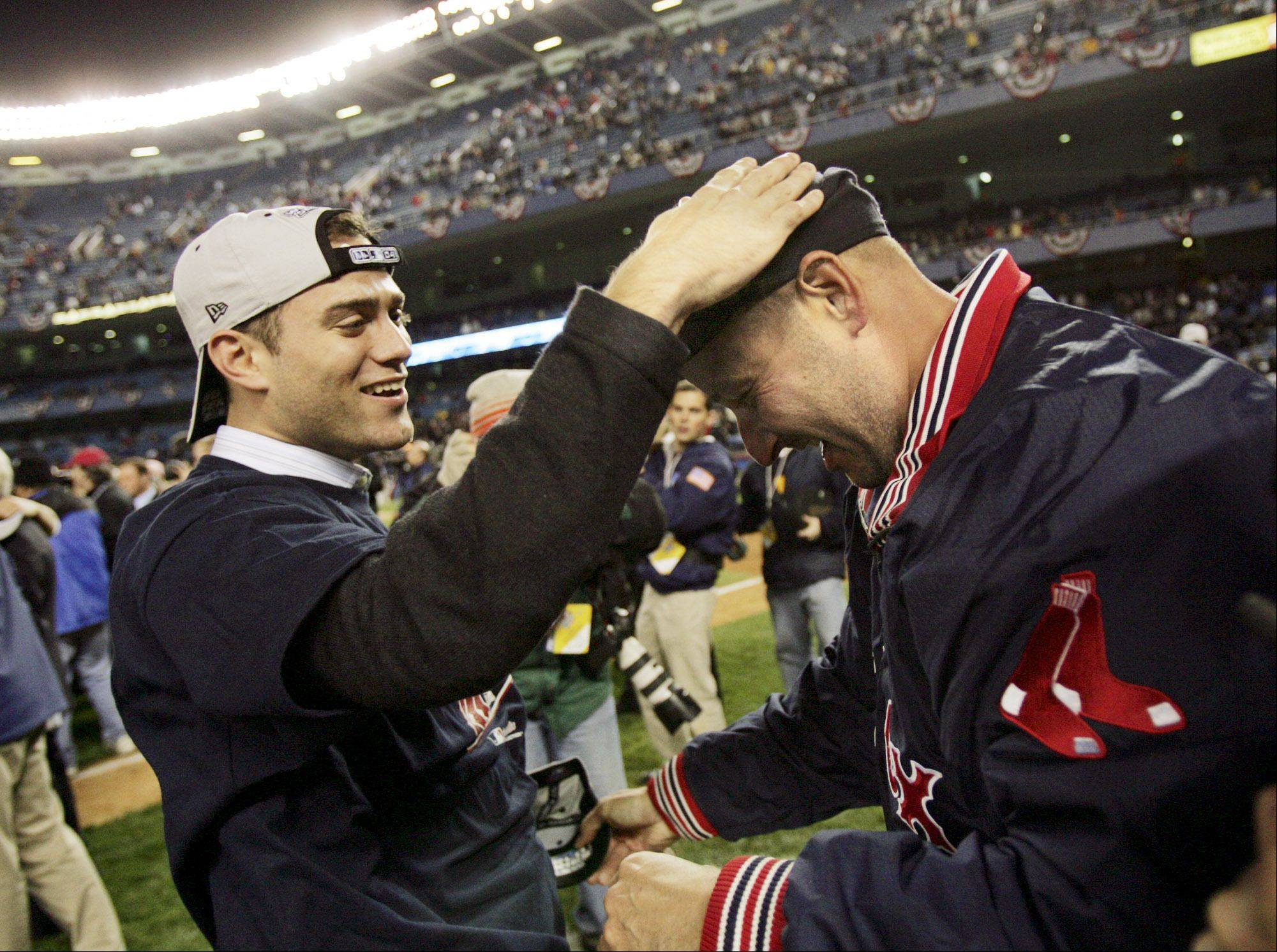 Boston Red Sox general manager Theo Epstein, left, and manager Terry Francona celebrate after Boston defeated the New York Yankees 10-3 in the deciding game of the AL championship series Wednesday, Oct. 20, 2004, in New York.