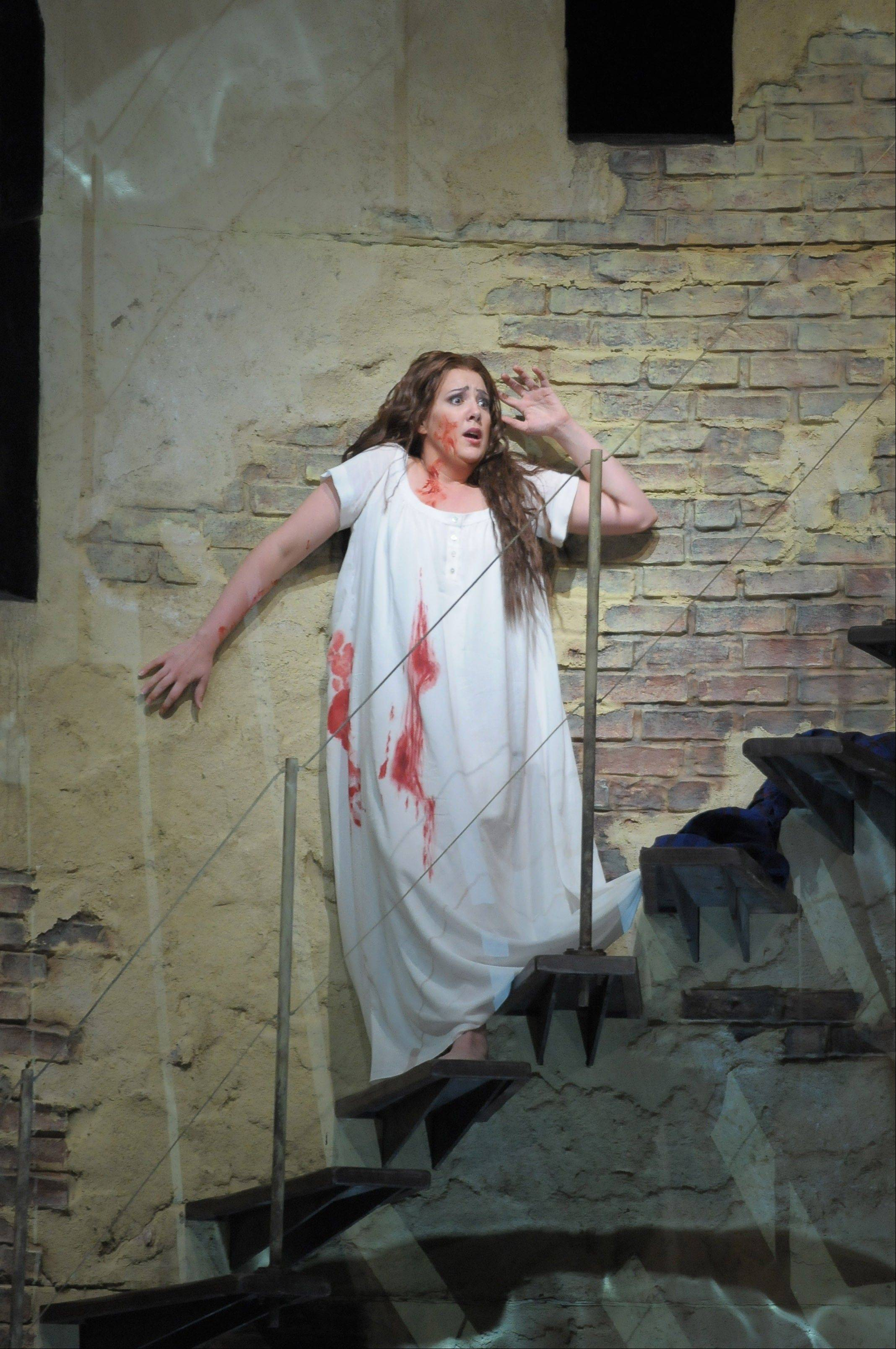 "Lucia (Susanna Phillips) goes murderously mad on her wedding night in the Lyric Opera of Chicago's new staging of Donizetti's tragedy ""Lucia di Lammermoor,"" directed by soprano Catherine Malfitano."