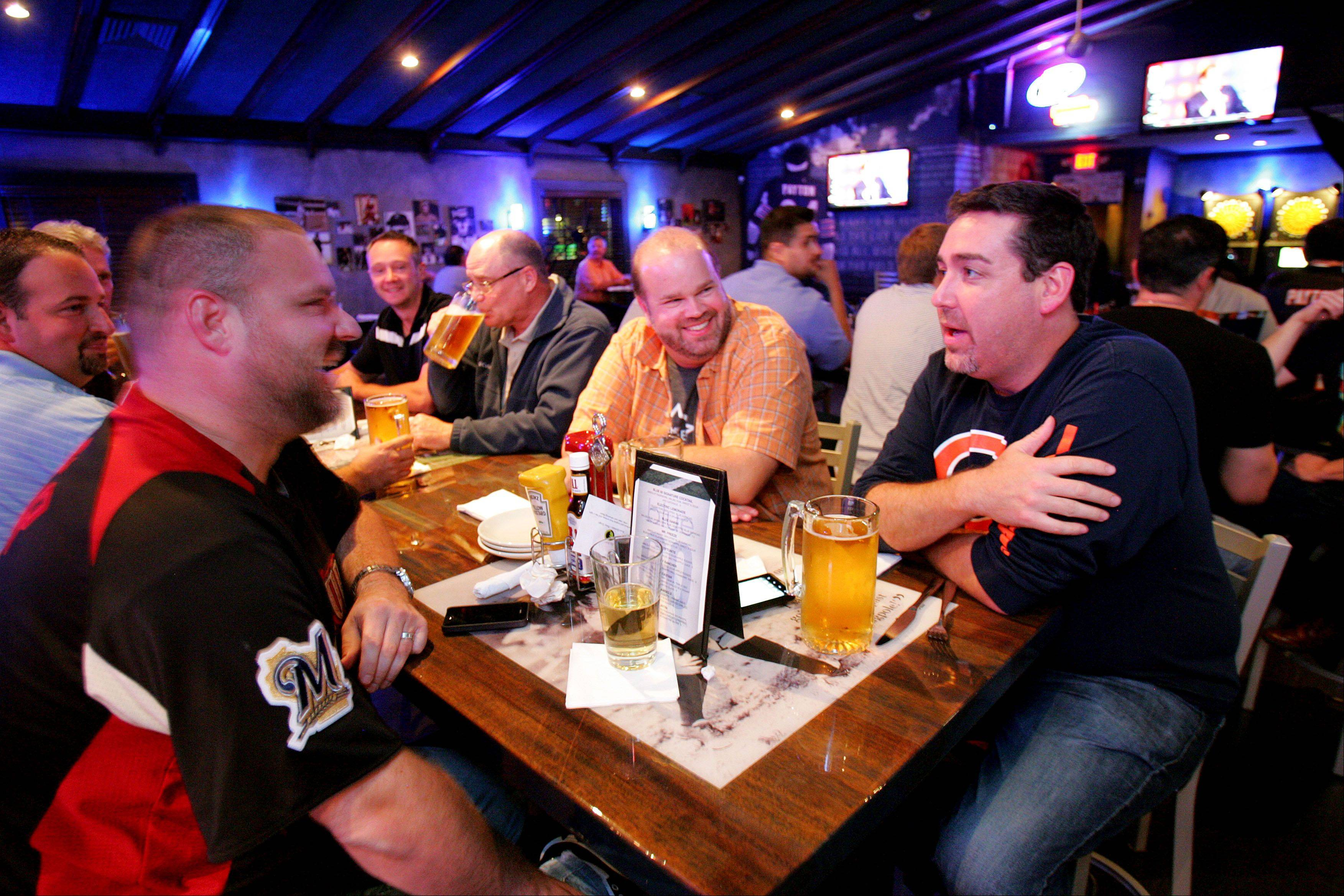 Dan Prass, left, Jeff Kruger and Evan Rullman of Vernon Hills hang out at Blue 60 sports bar in Mundelein.