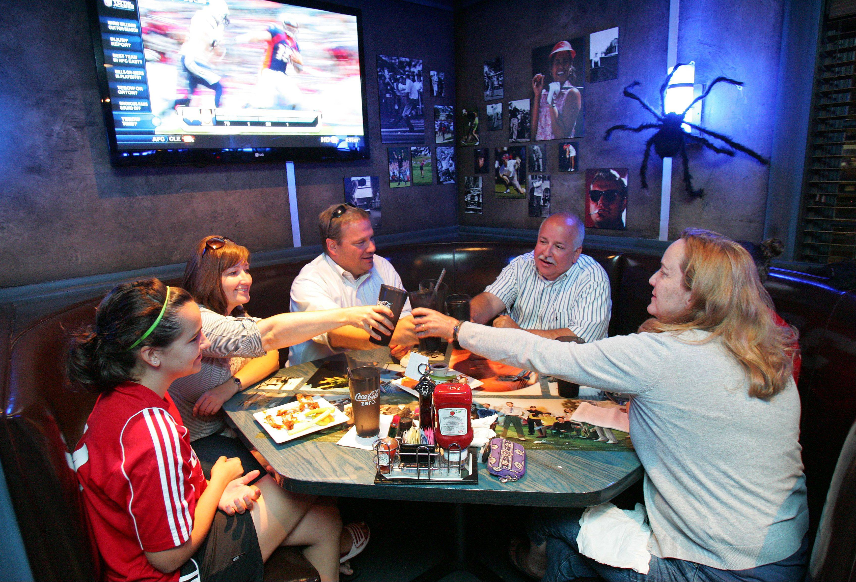 The Petrich and Cain families grab dinner at Blue 60 sports bar in Mundelein.