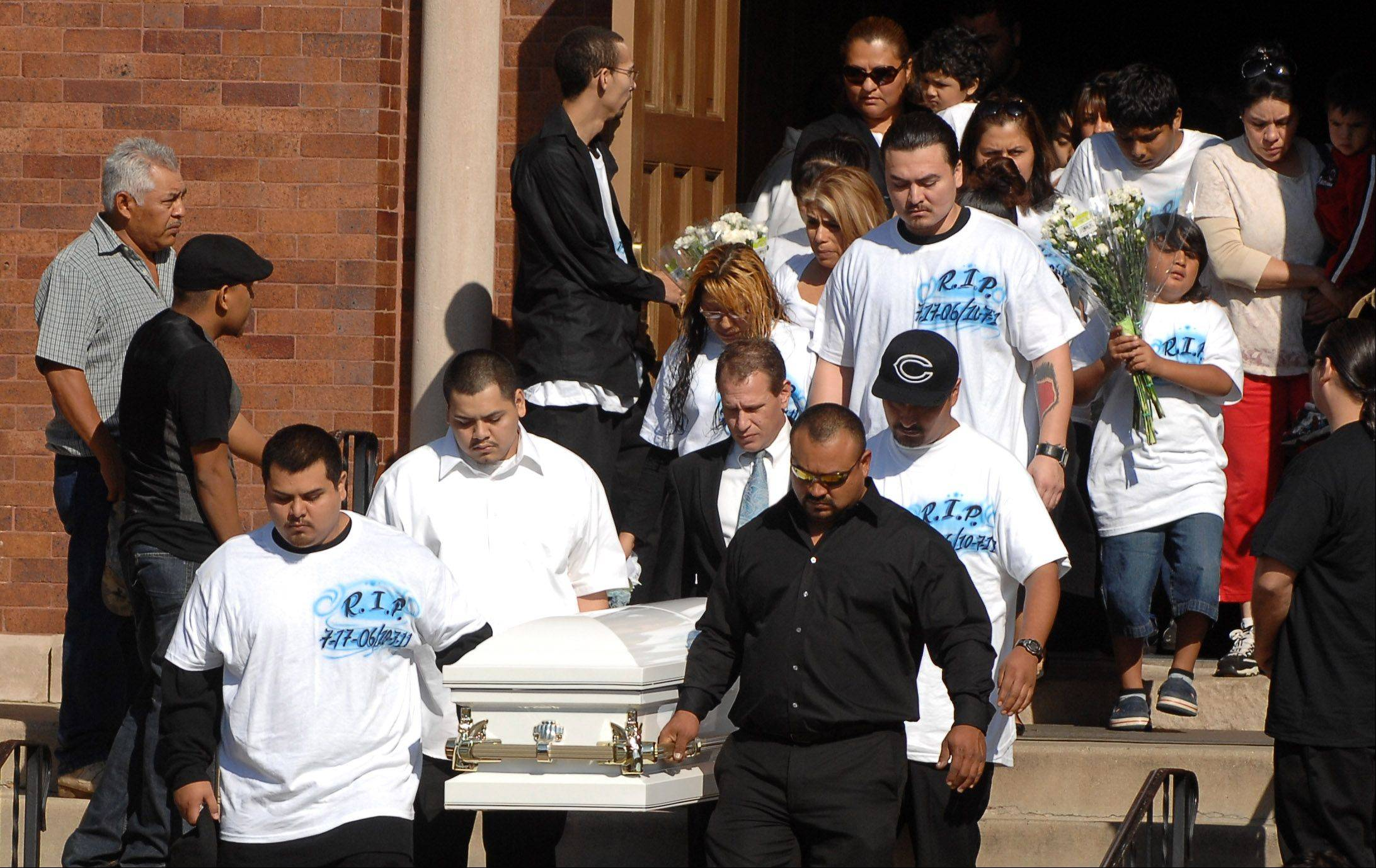 Pallbearers carry the casket following the funeral of 5-year-old Eric M. Galarza Jr. at St. Joseph Catholic Church Wednesday. The boy was killed Friday night in a gang-related shooting in Elgin. His parents Eric and Denisse are following the casket.