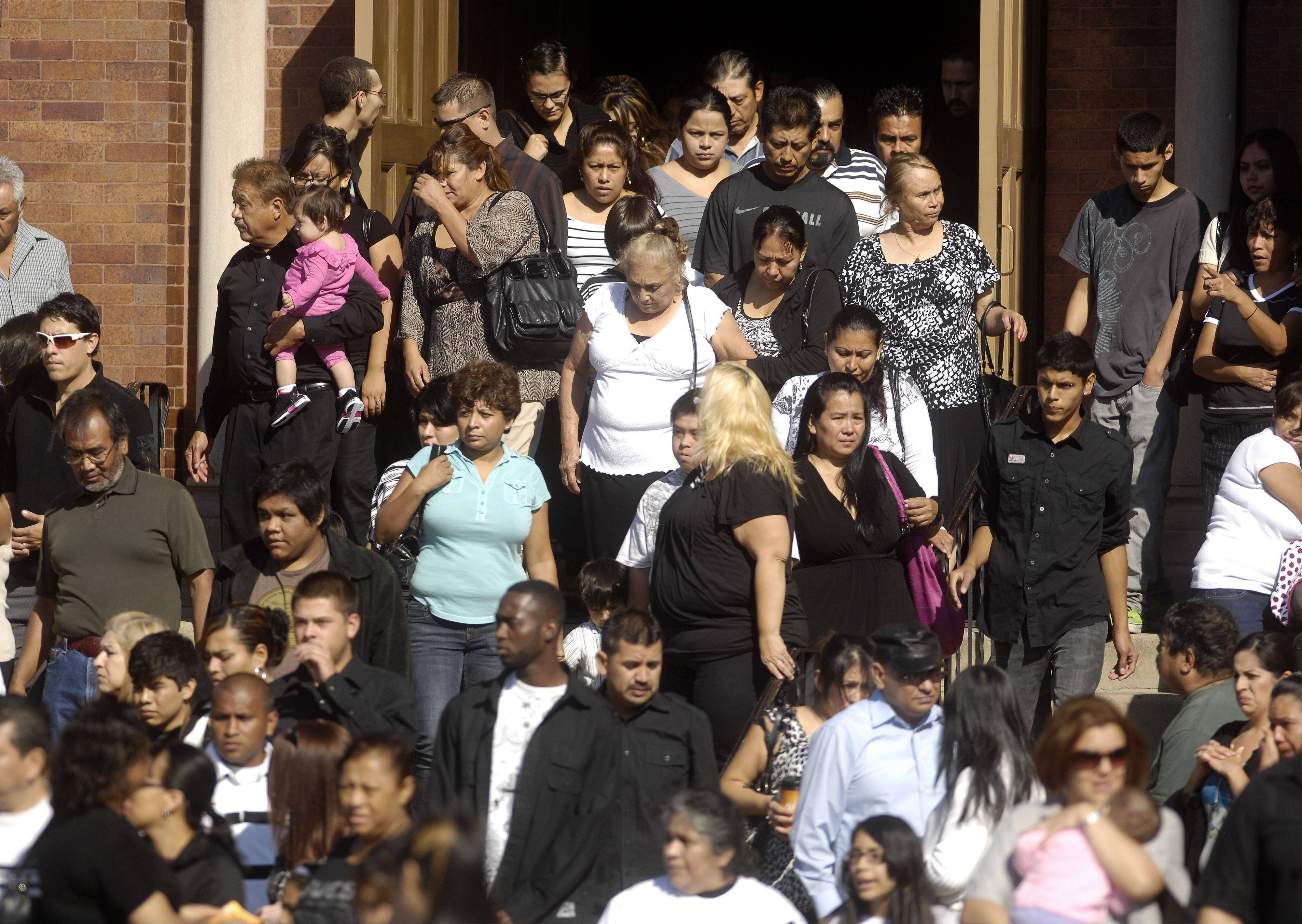 A large crowd leaves St. Joseph Catholic Church in Elgin Wednesday following the funeral for 5-year-old Eric M. Galarza Jr., who was killed Friday night.