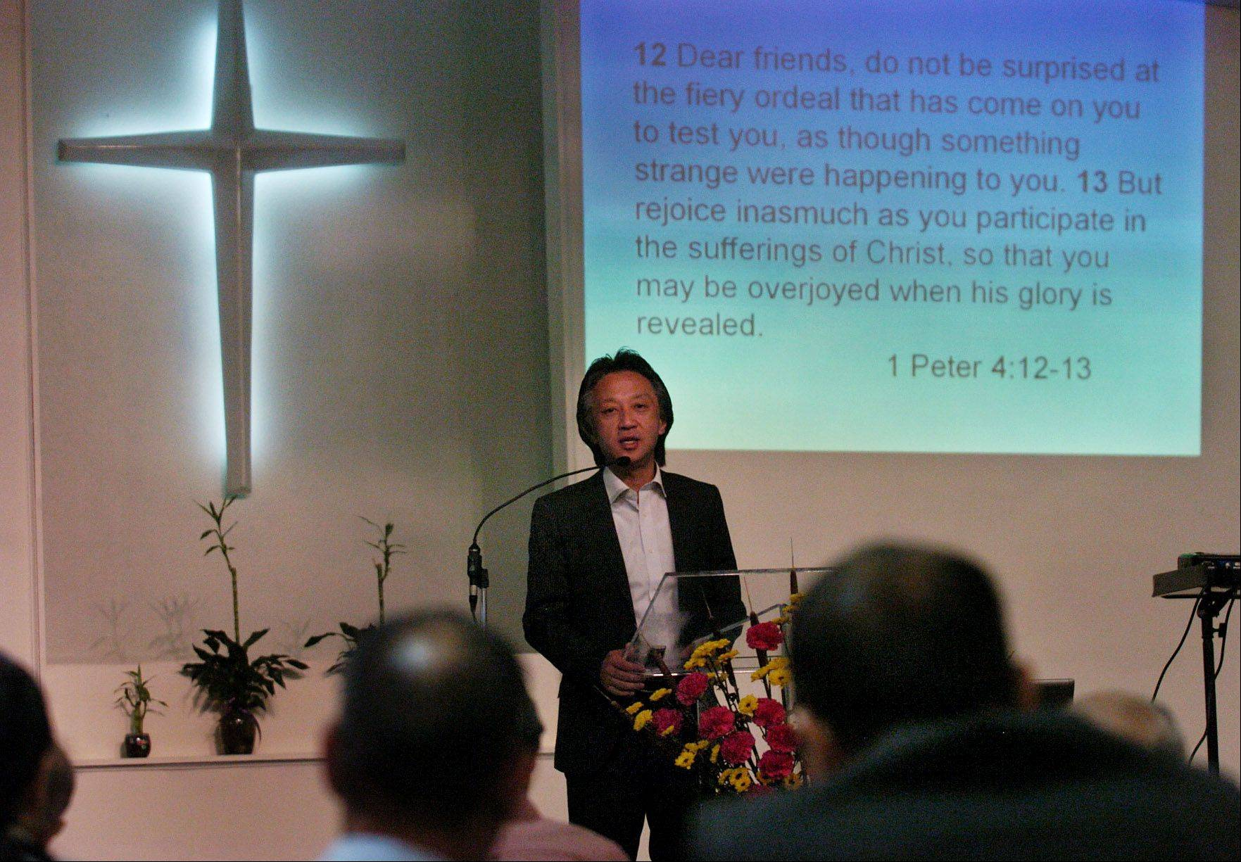 Rev. Akira Sato, a minister whose churches were lost after the Japanese tsunami, talks at the Japanese Mission Baptist Church in Schaumburg.