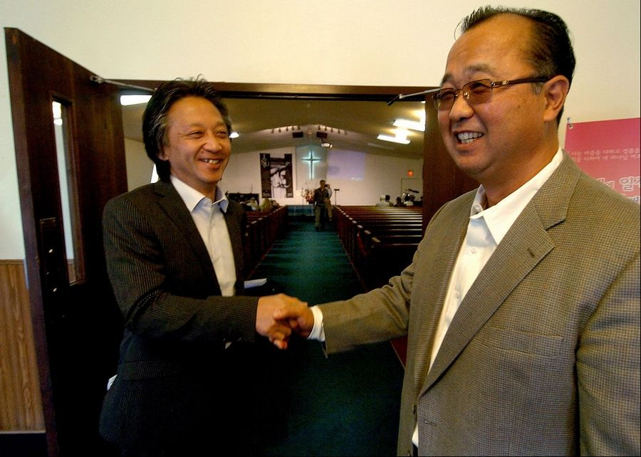The Rev. Yugo Kobari of the Japanese Mission Baptist Church in Schaumburg hosted the Rev. Akira Sato, left, who lost his churches to the Japanese earthquake, tsunami and nuclear power plant meltdown.