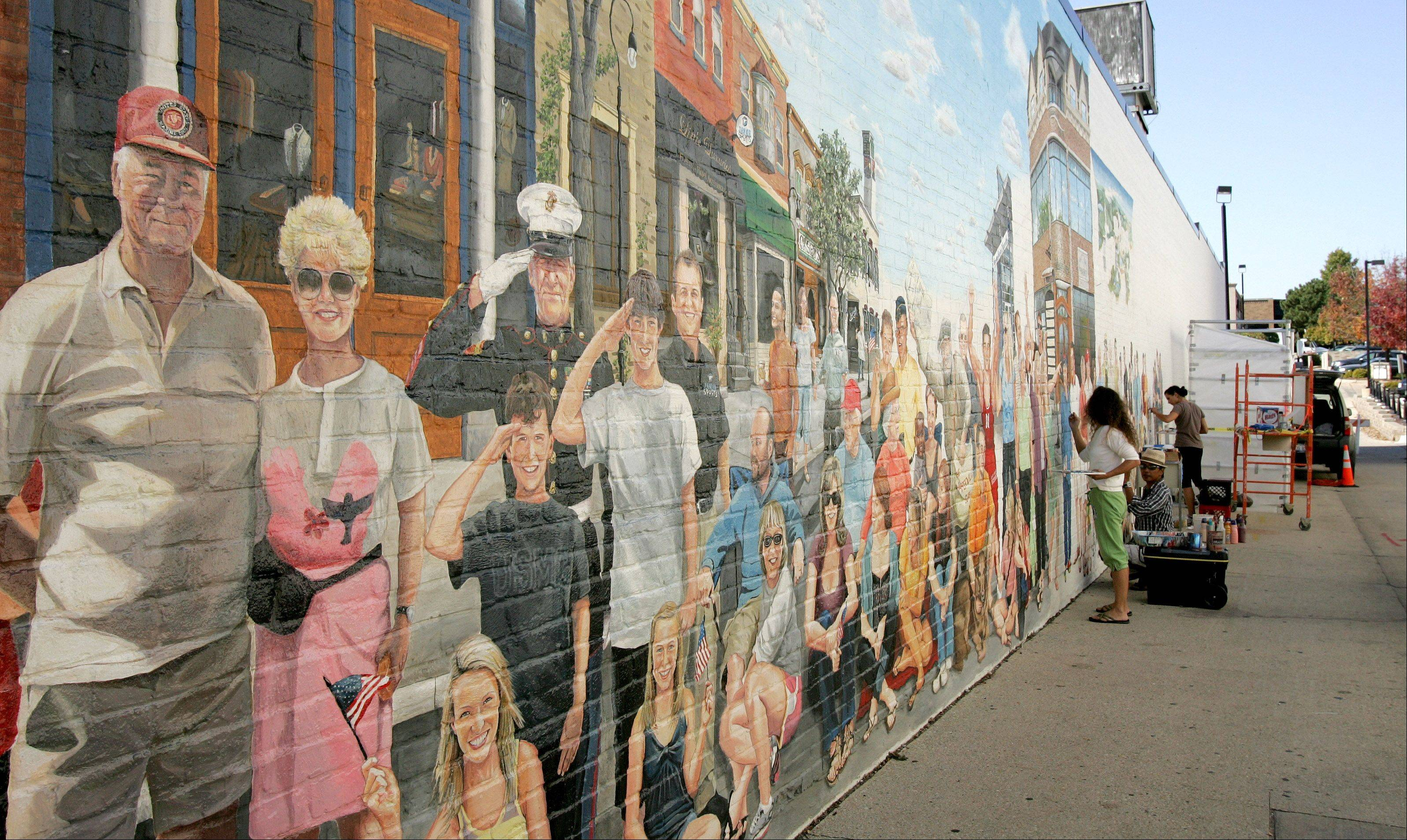 "Artists plan to work on the ""Naperville Loves a Parade"" mural in downtown Naperville through the end of November."
