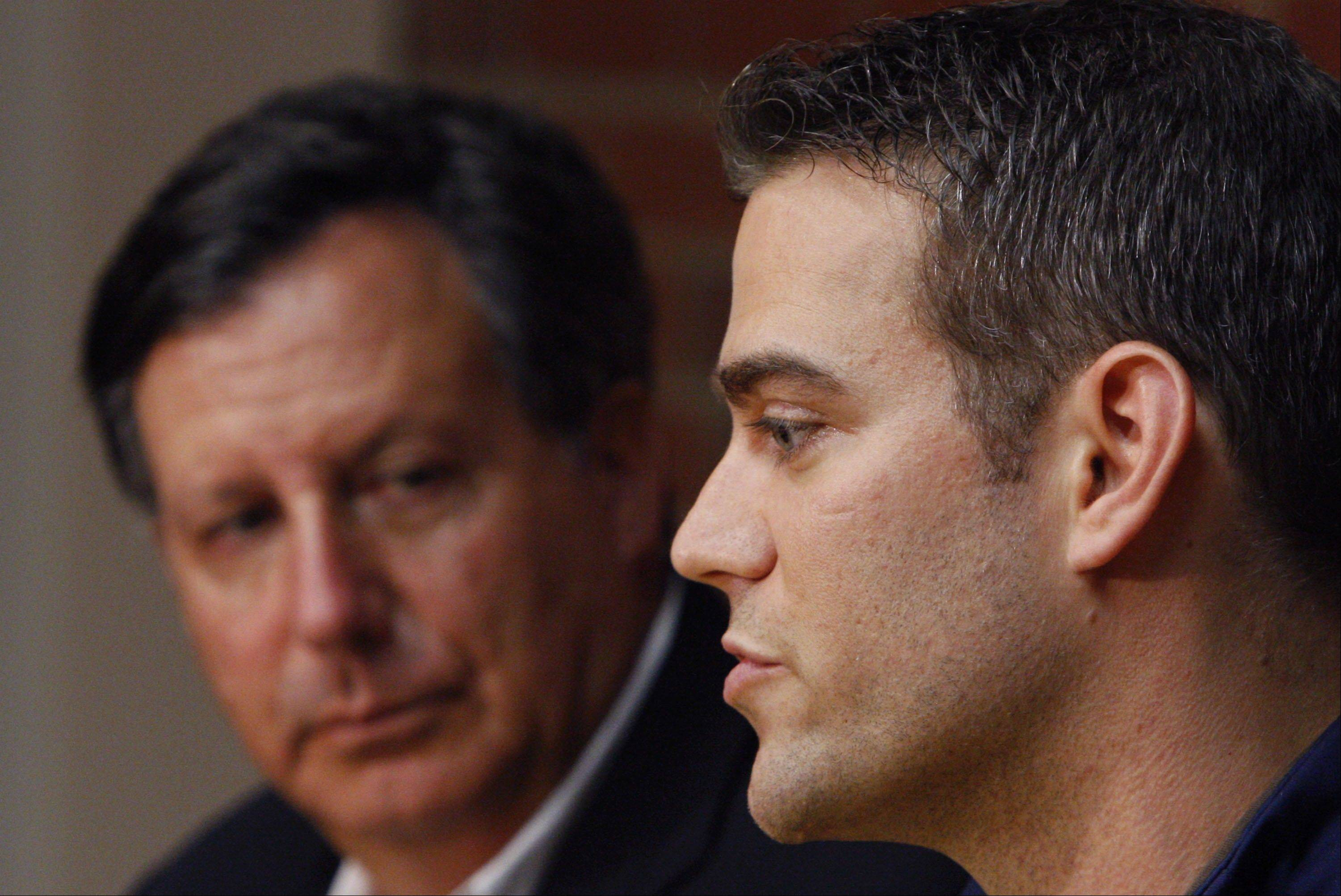 Theo Epstein speaks during a news conference in Boston at the end of the season. Epstein reportedly has signed a 5-year contract with the Cubs for $20 million, according to ESPN's Buster Olney.