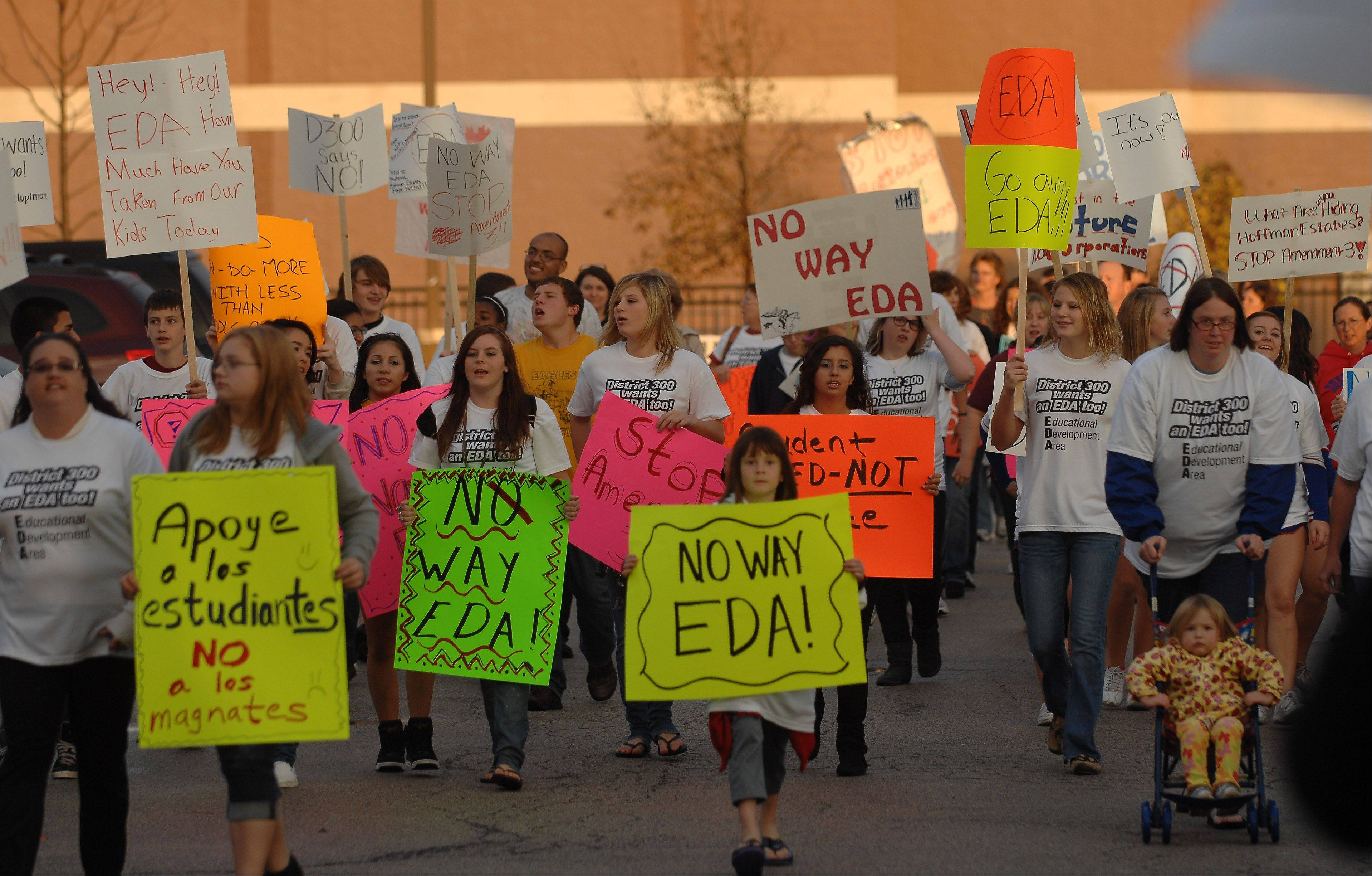 Students, teachers and parents march in protest over the possible extension of the Sears Economic Development Area during an event at Jacobs High School in Algonquin Thursday.