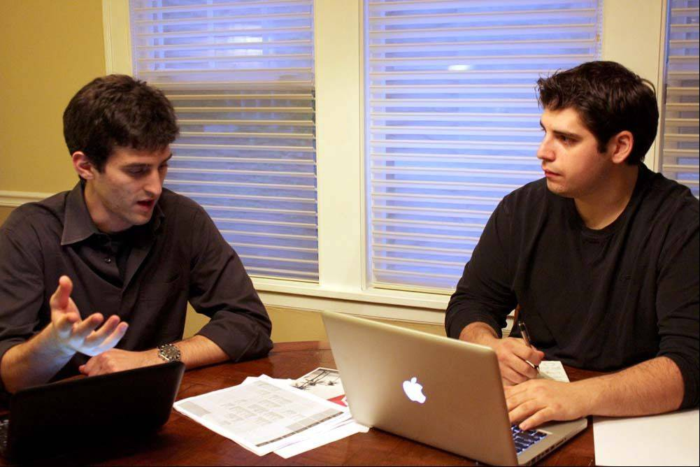 Courtesy of SoundOff.fmLifelong friends Dan Arwady and Jim Skuros work on details of their SoundOff.fm website that pits bands against each other.