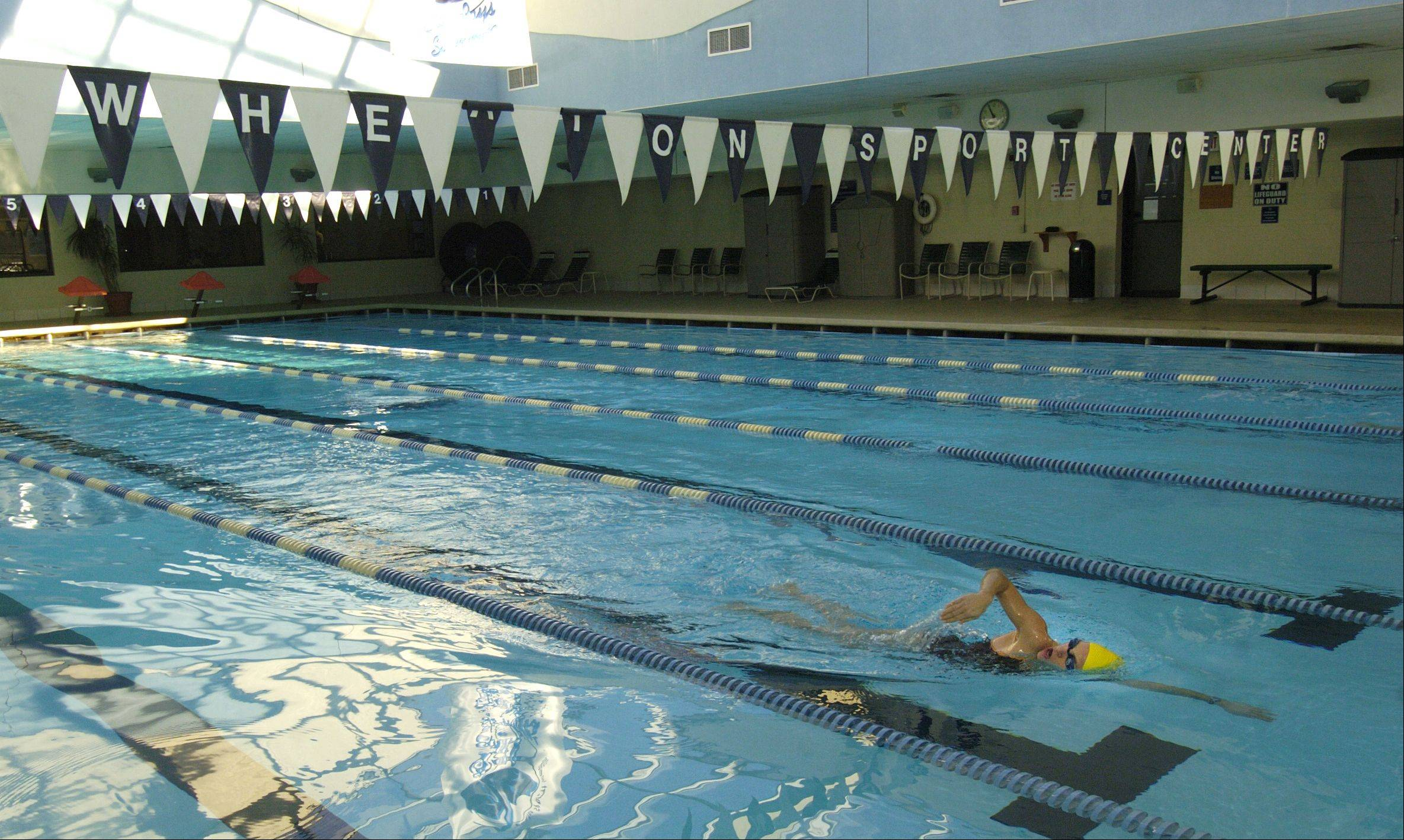 The main lap pool at the Wheaton Sports Center complies with federal and state safety rules that require new pool drain covers. Still, the club is on the state's list of noncompliant swimming facilities because drain repairs on two of its hot tubs haven't been made.