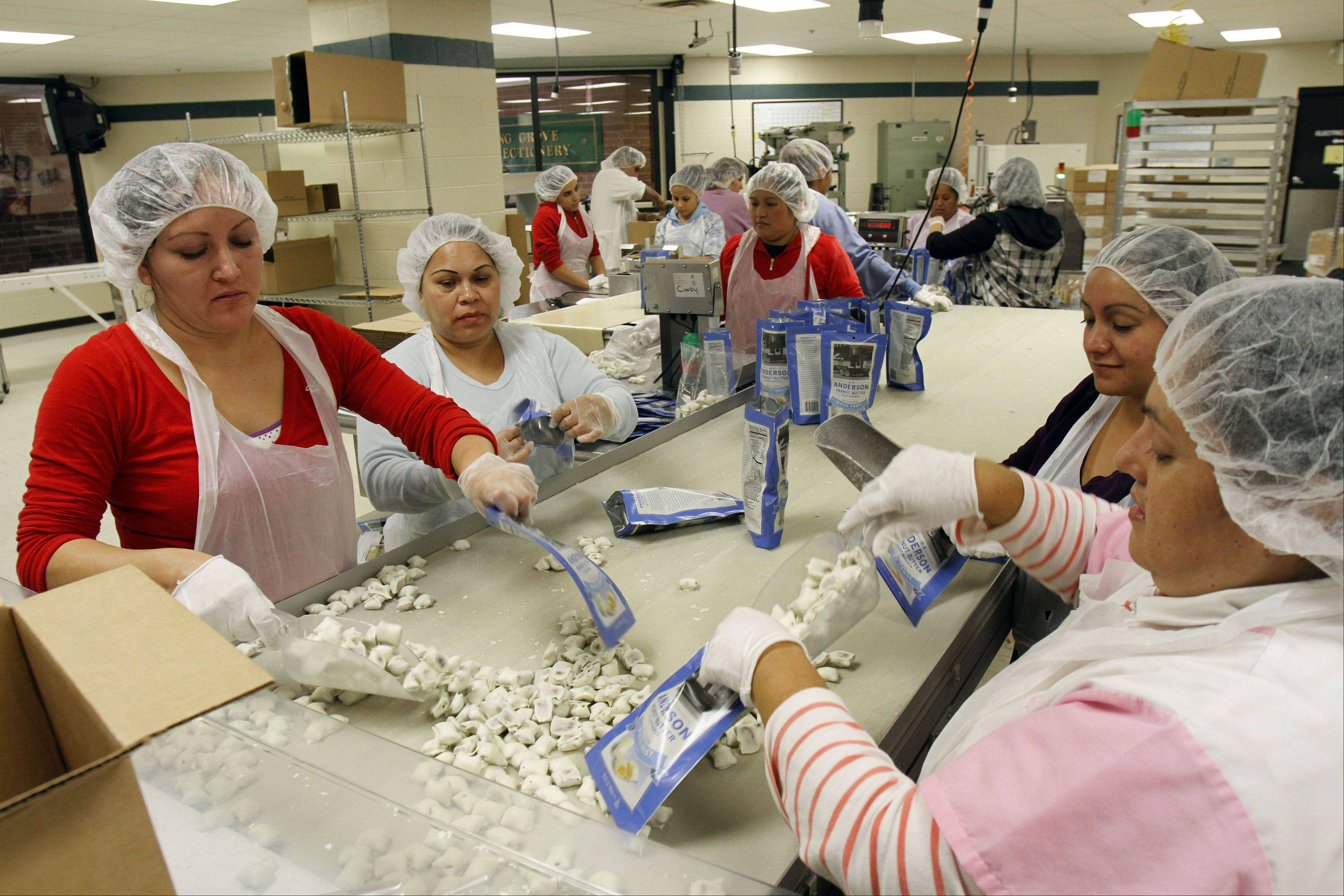 Workers sort candy into bags inside the facility.