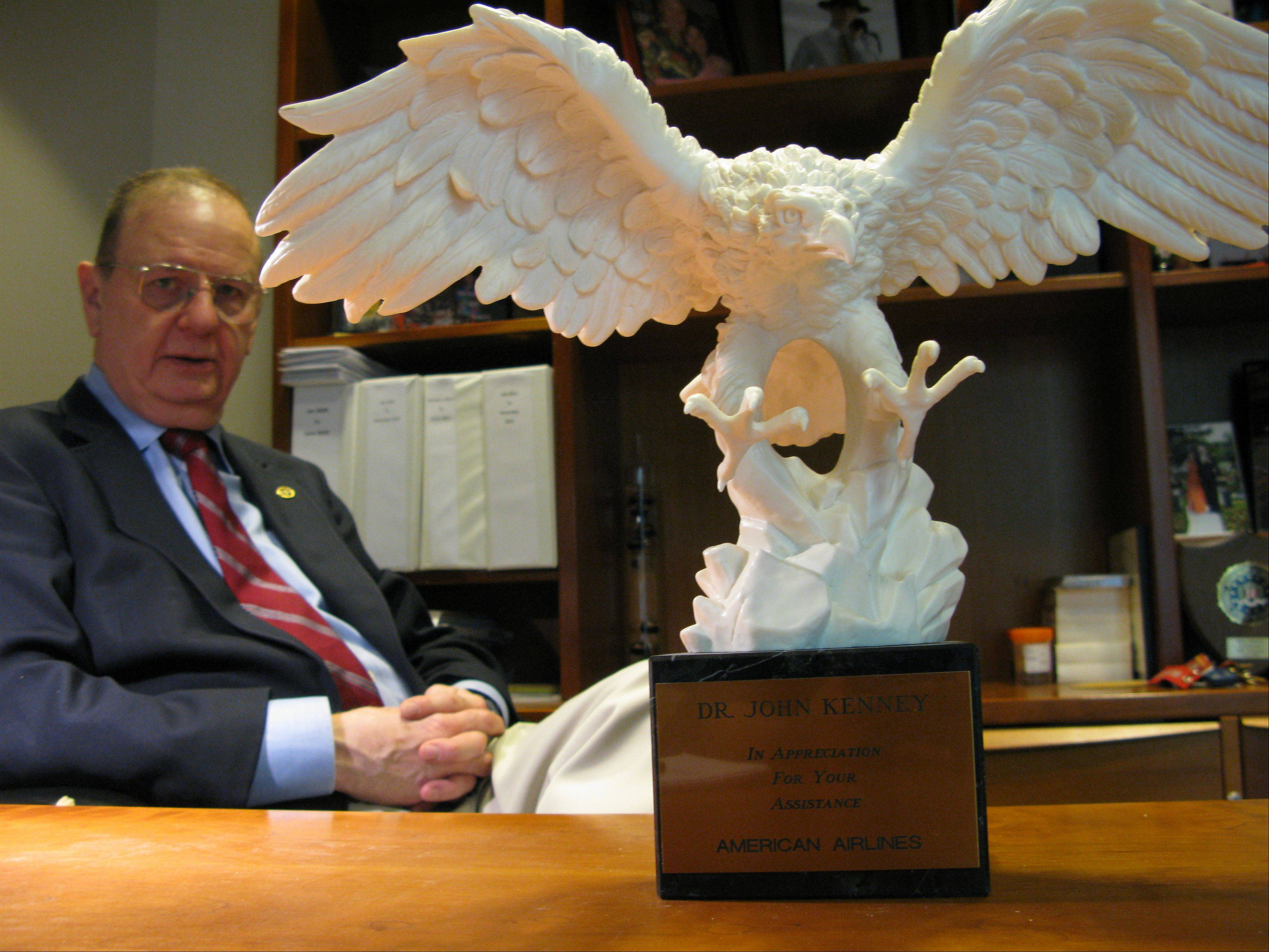 Dr. John Kenney of Park Ridge was among a team of 30 forensic dentists tapped to identify the 273 victims of the American Airlines Flight 191 crash on May 25, 1979. American Airlines awarded Kenney the eagle statue for his work identifying the victims of plane crashes.