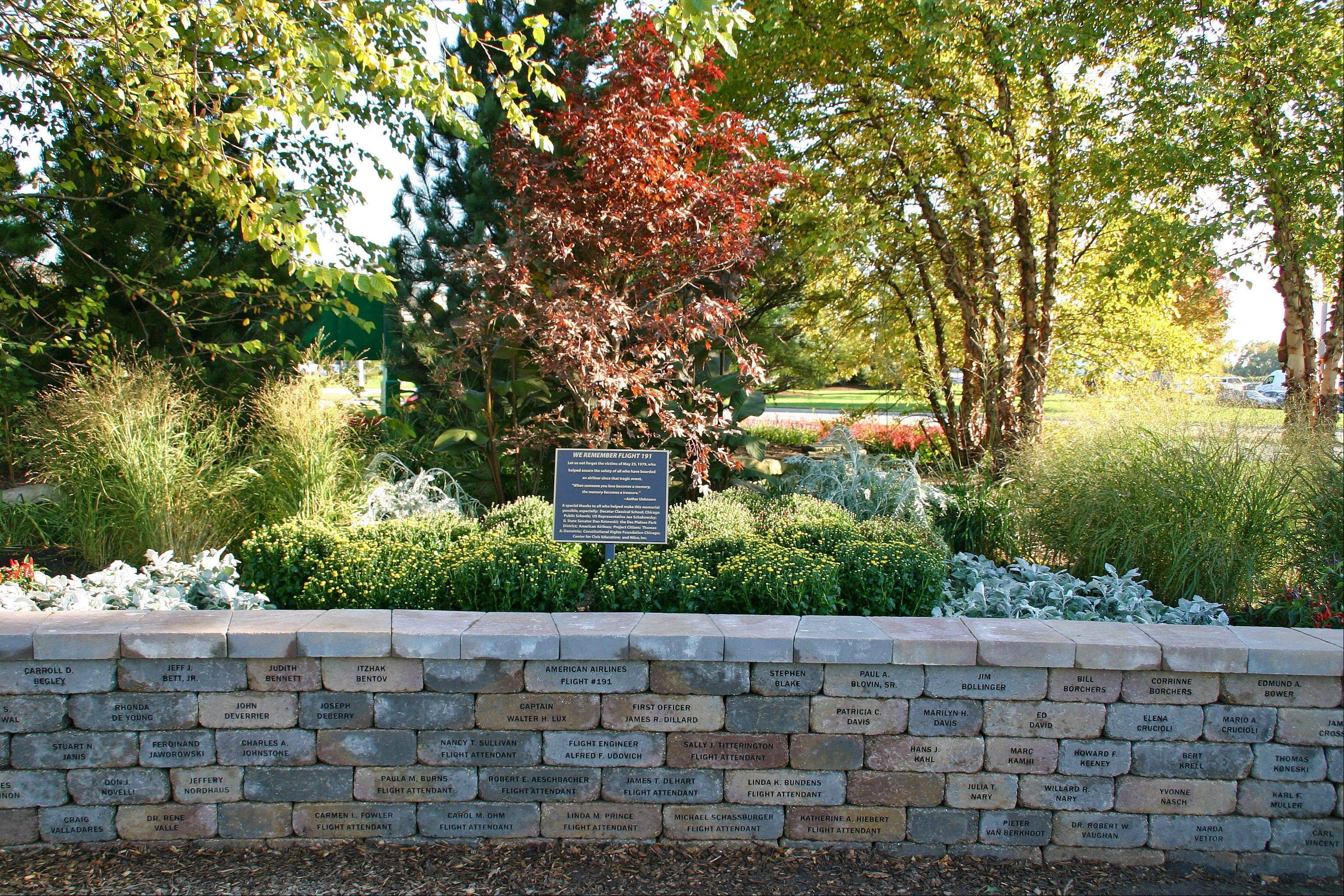 A dedication ceremony for the American Airlines Flight 191 Memorial will be held at 11 a.m. Saturday at Lake Park in Des Plaines. The memorial includes bricks for each of the 273 victims. A brass plaque and a red maple tree, chosen by students at Decatur Classical School in Chicago, stand in a flower bed behind the wall.