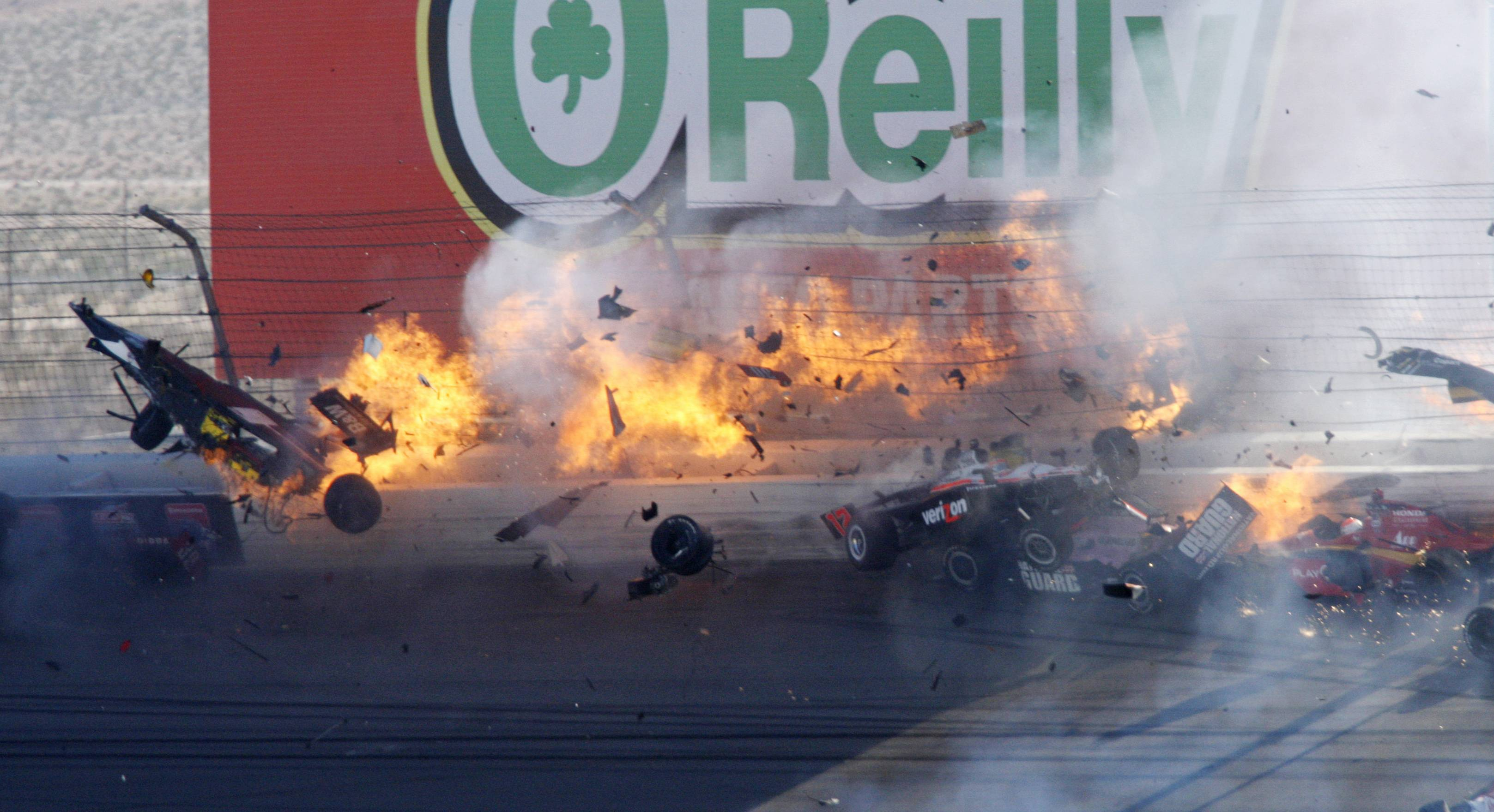 Drivers crash Sunday during a wreck that involved 15 cars during the IndyCar Series' auto race at Las Vegas Motor Speedway in Las Vegas.