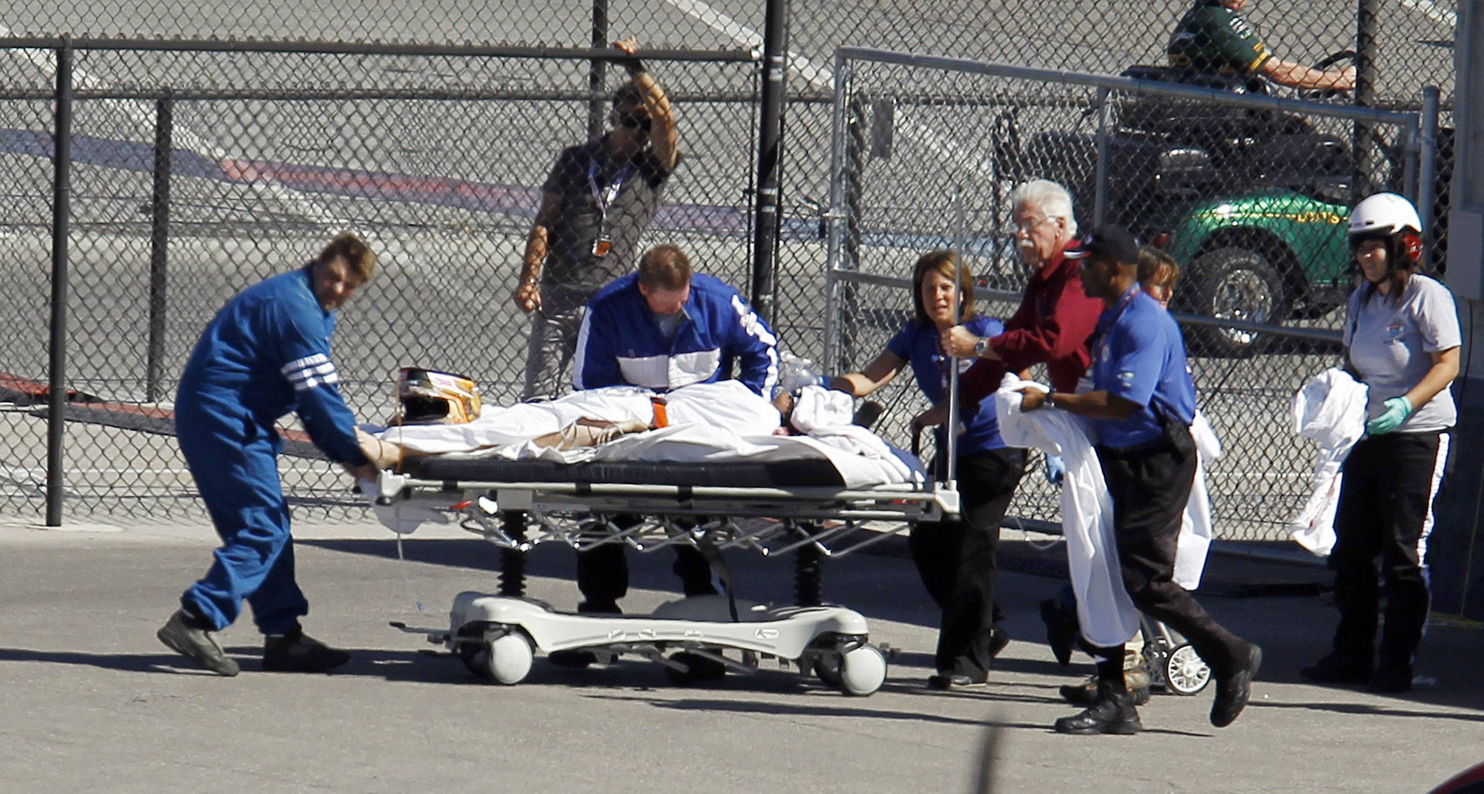 Dan Wheldon of England  is taken to a medical helicopter Sunday after a crash early in the IndyCar Series' Las Vegas Indy 300. Wheldon later died.