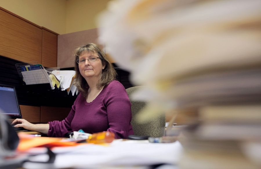 "Leigh Ann Stephens, executive director of DuPage Center for Independent Living, is seen in her office in Glen Ellyn. Stephens wrote a letter in August ""asking, pleading"" for $50,000 the state owed to the DuPage Center for Independent Living. It was the third time in two years that she had sent a hardship letter warning the center, which helps people with disabilities live outside of costly nursing homes, would close if it wasn't paid."