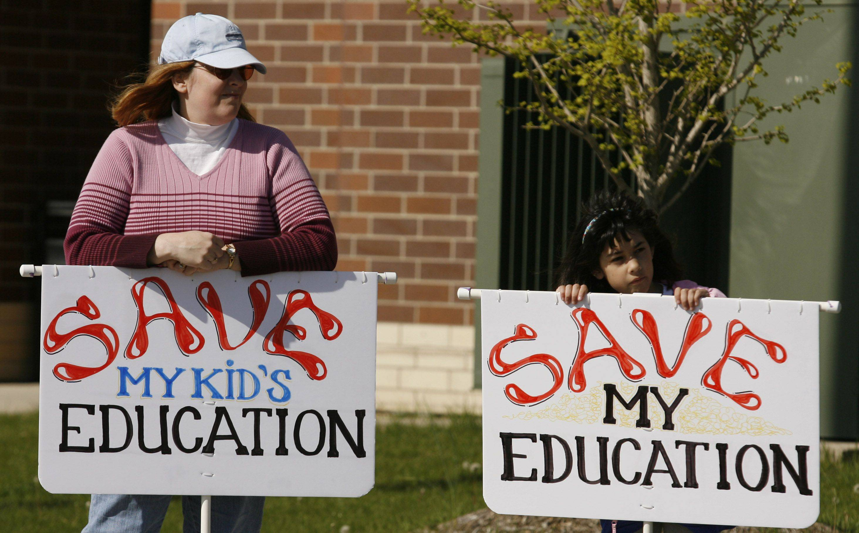CHRISTOPHER HANKINS/chankins@dailyherald.com � Debbie Pangilinan and her daughter Angel, a third grader at Nature Ridge Elementary School in Bartlett, show their support for education funding rally at South Elgin High School.